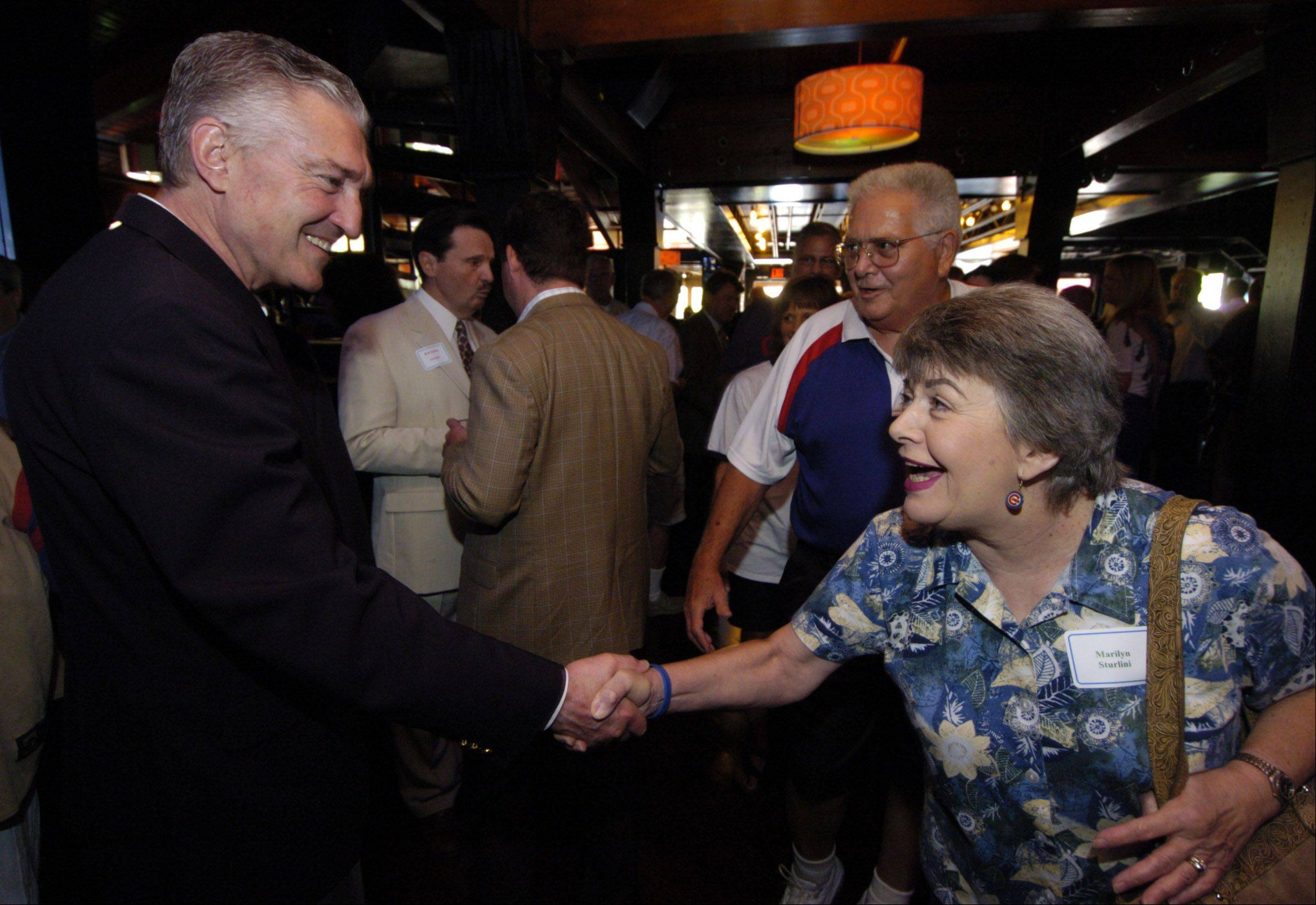 Marilyn Sturlini of Rolling Meadows greets Cubs radio broadcaster Pat Hughes during a Subscriber Total Access event celebrating the life of Ron Santo, at Drink Nightclub in Schaumburg Thursday.