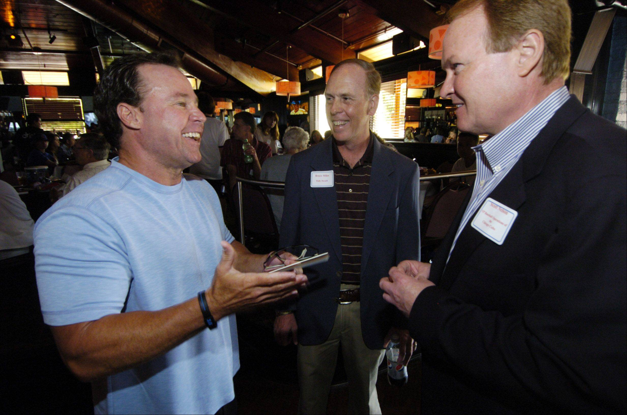 Ron Santo Jr., left, talks with Daily Herald Cubs beat writer Bruce Miles, center, and Scott Nelson, vice president of baseball operations for the Chicago Cubs, during a Subscriber Total Access event celebrating the life of Ron Santo, at Drink Nightclub in Schaumburg Thursday.