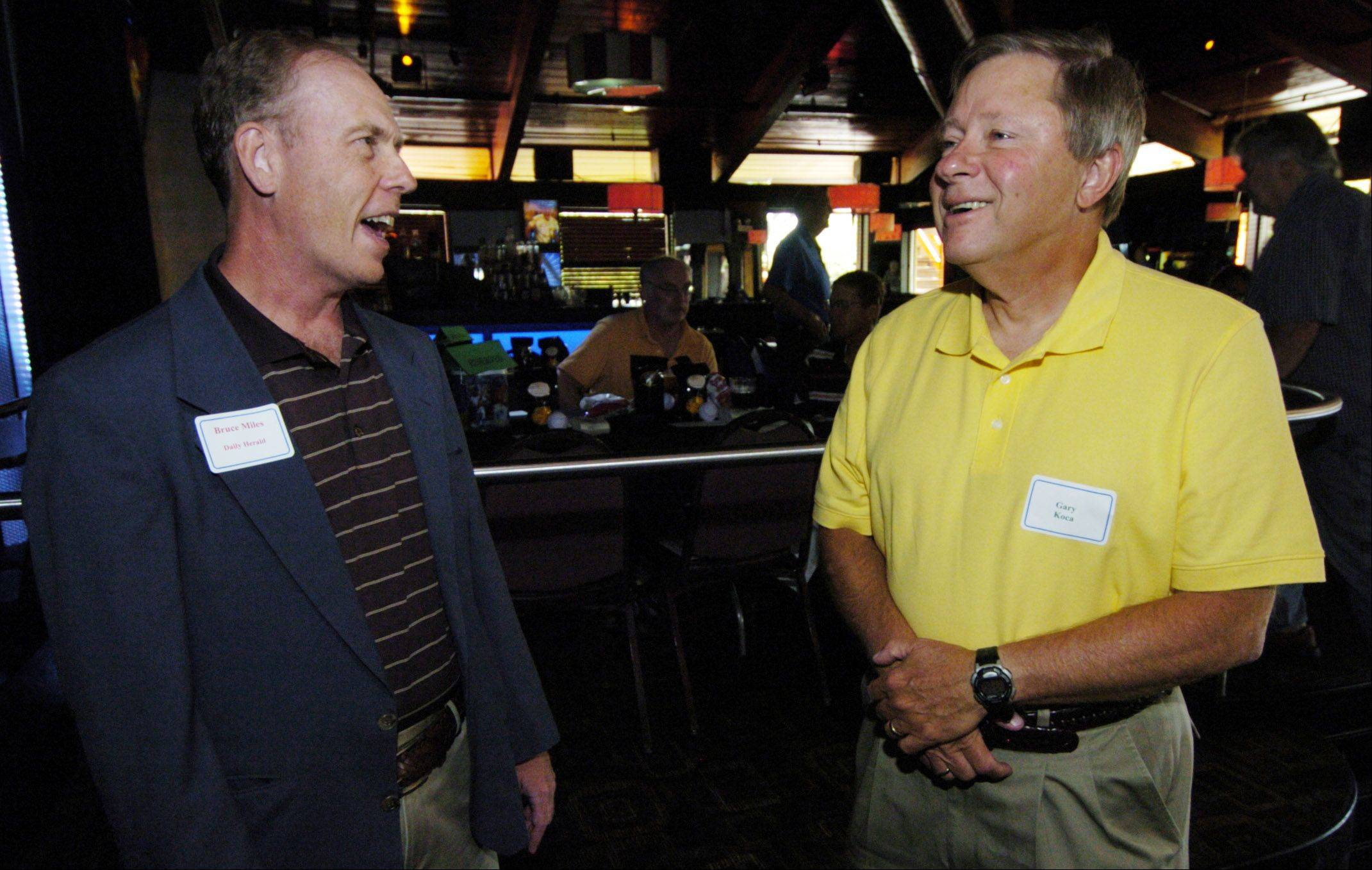 Cubs beat writer Bruce Miles, left, talks with Gary Koca of Pingree Grove during a Subscriber Total Access event celebrating the life of Ron Santo.