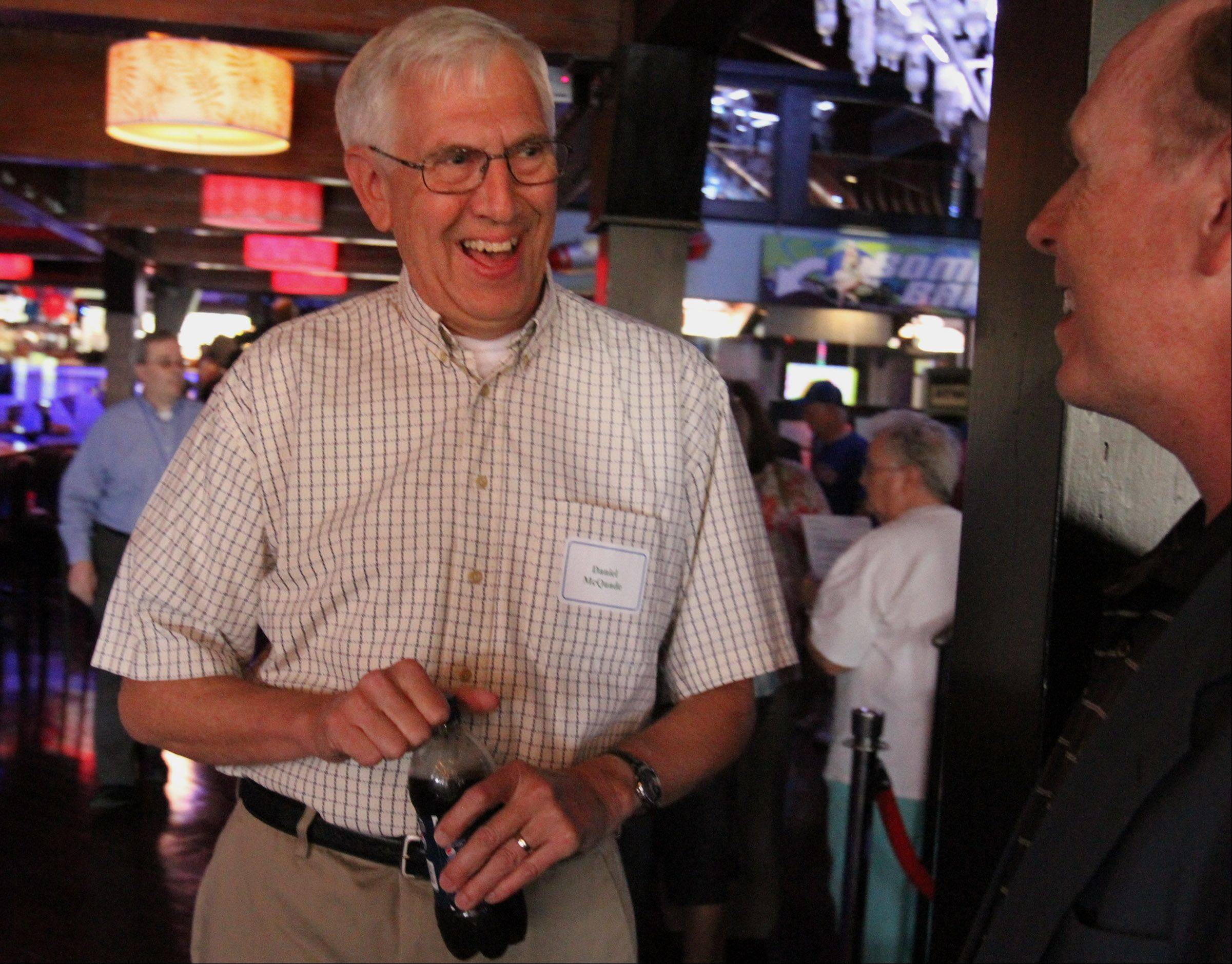 Daniel McQuade of Schaumburg talks with at Daily Herald Cubs writer Bruce Miles at the Daily Herald Total Access event celebrating Ron Santo's life at Drink in Schaumburg on Thursday.