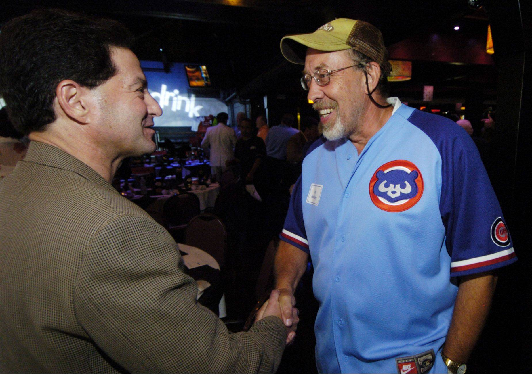 Daily Herald sports columnist Barry Rozner greets subscriber Jeff Benchley of Elgin during a Subscriber Total Access event celebrating the life of Ron Santo.