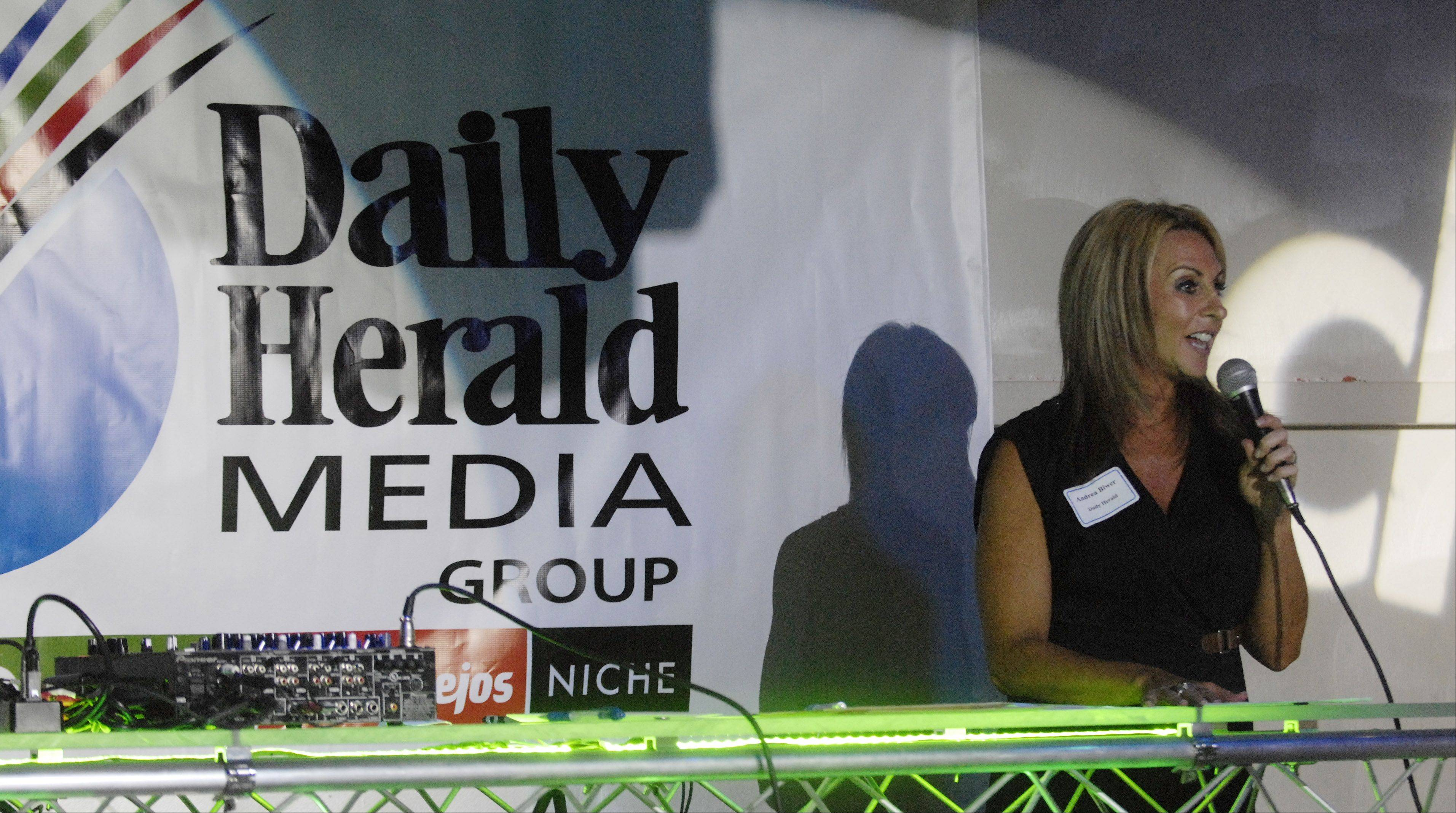 Andrea Biwer of the Daily Herald speaks during the Subscriber Total Access event.