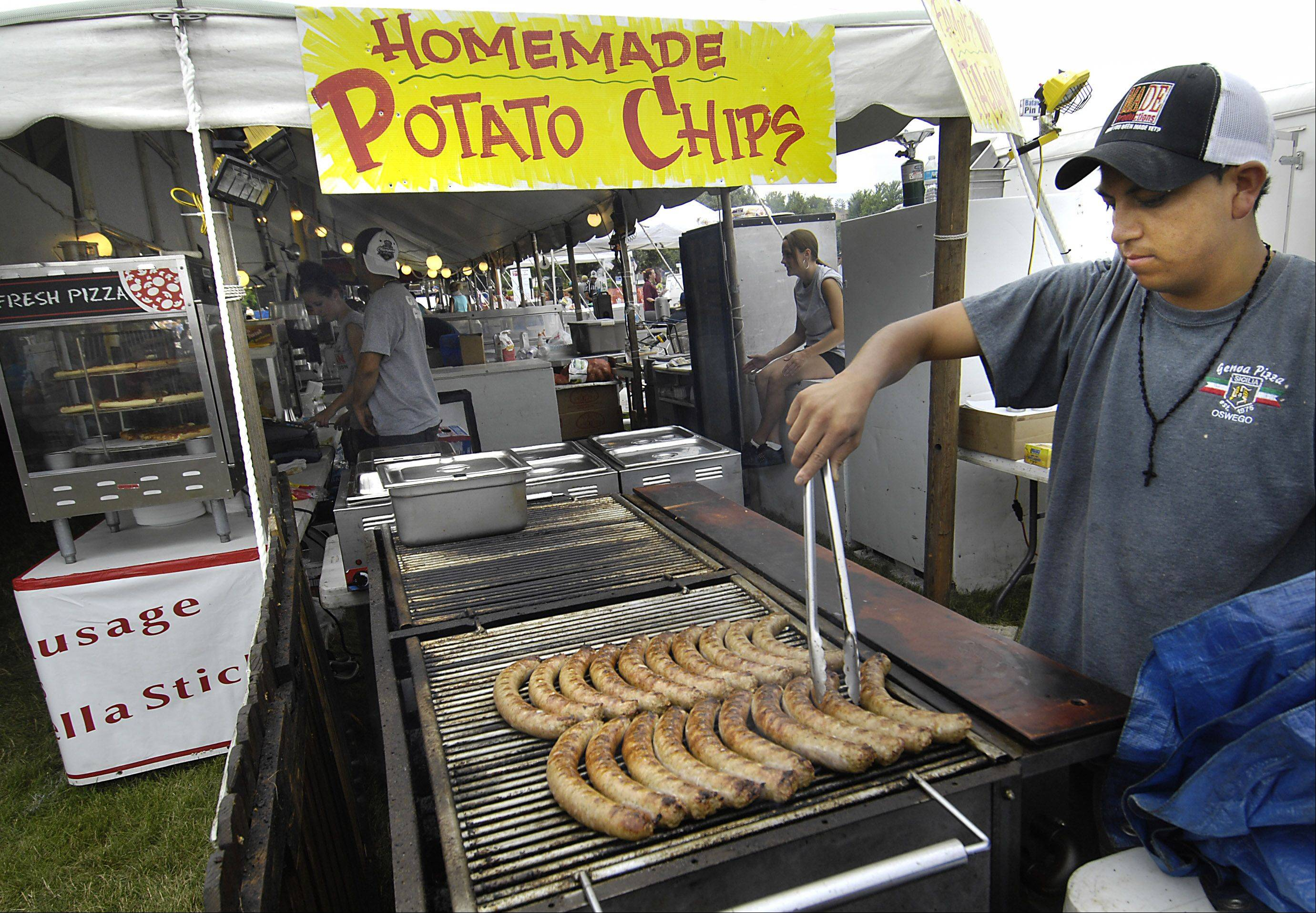 Festival food, anyone? Julio Garcia grills sausage and hamburgers at the Genoa Pizza stand during the last day of last year's Batavia's Windmill City Festival.