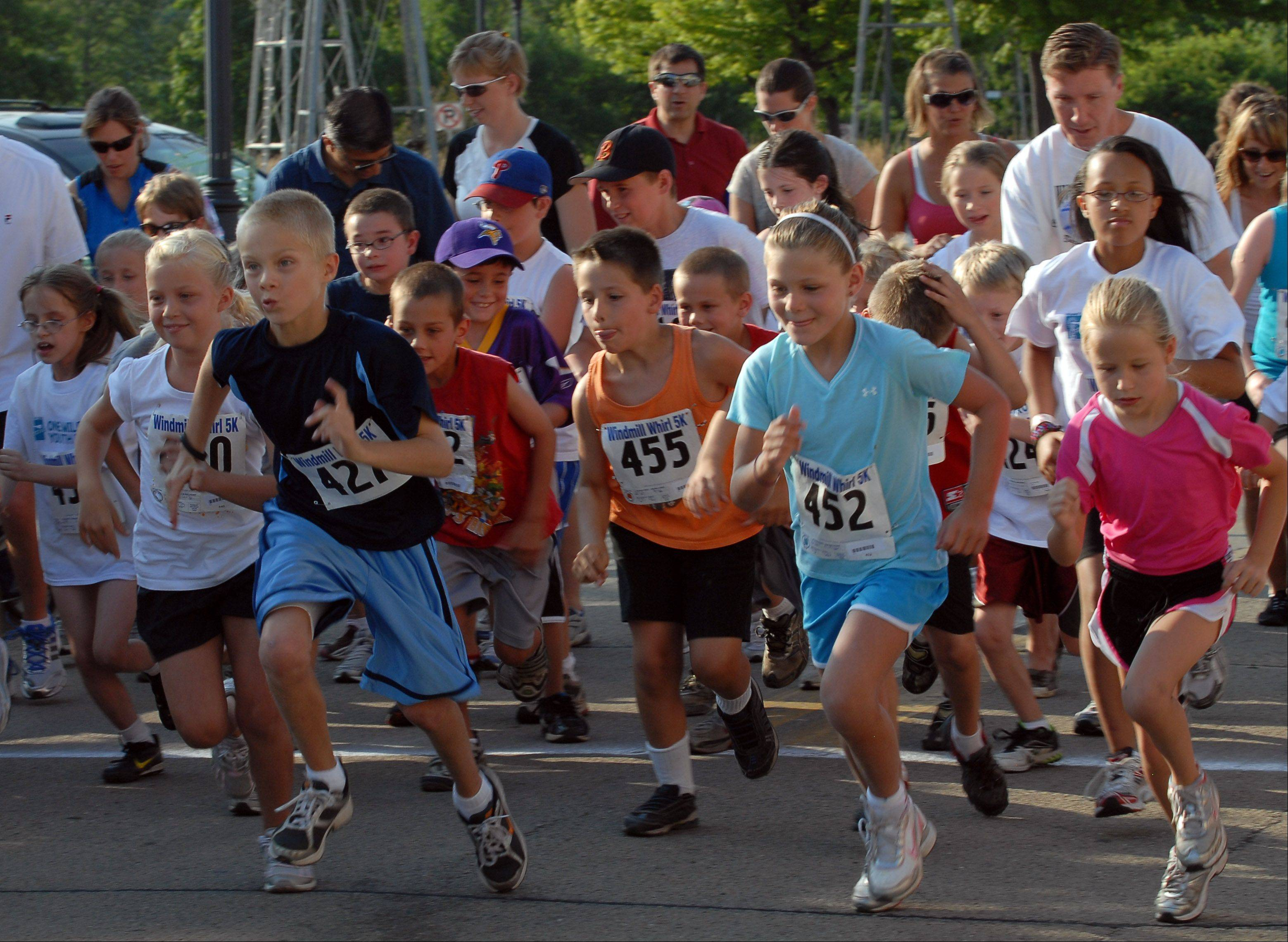 The Windmill Whirl kids' race takes off at last year's Windmill City Festival in Batavia.