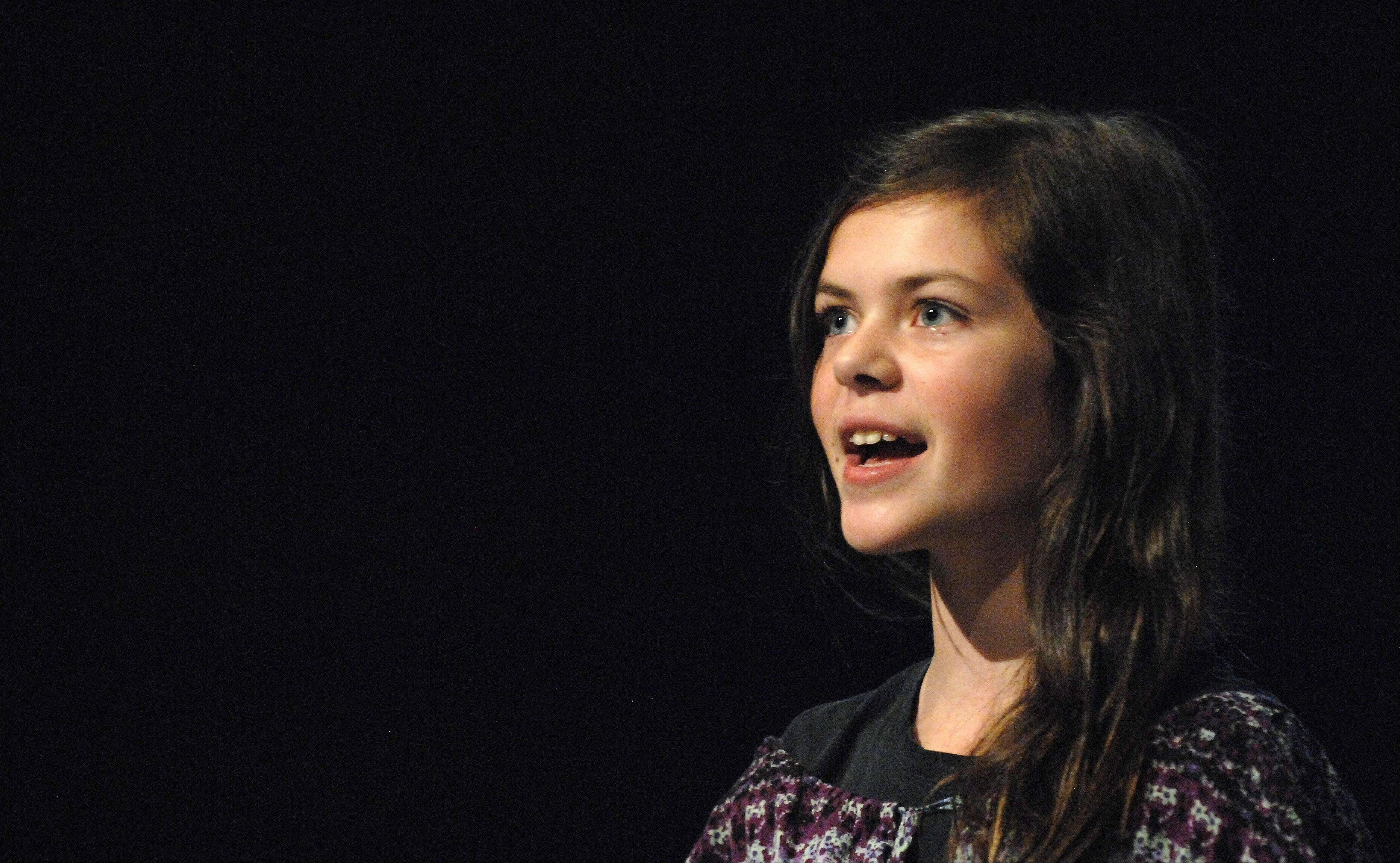 "Bridgette Rathjen, 11, of Elgin, performs a solo during a rehearsal of ""Destined Lives."""