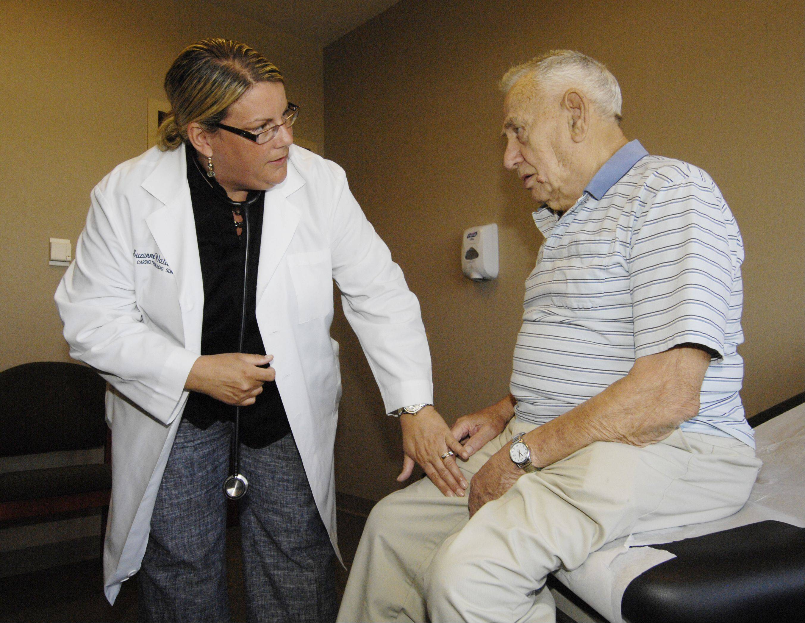 "Anthony ""Duff"" Hufnagel, 93, of Glen Ellyn, meets with nurse Suzanne Wallace to follow up on his pioneering heart valve replacement surgery."
