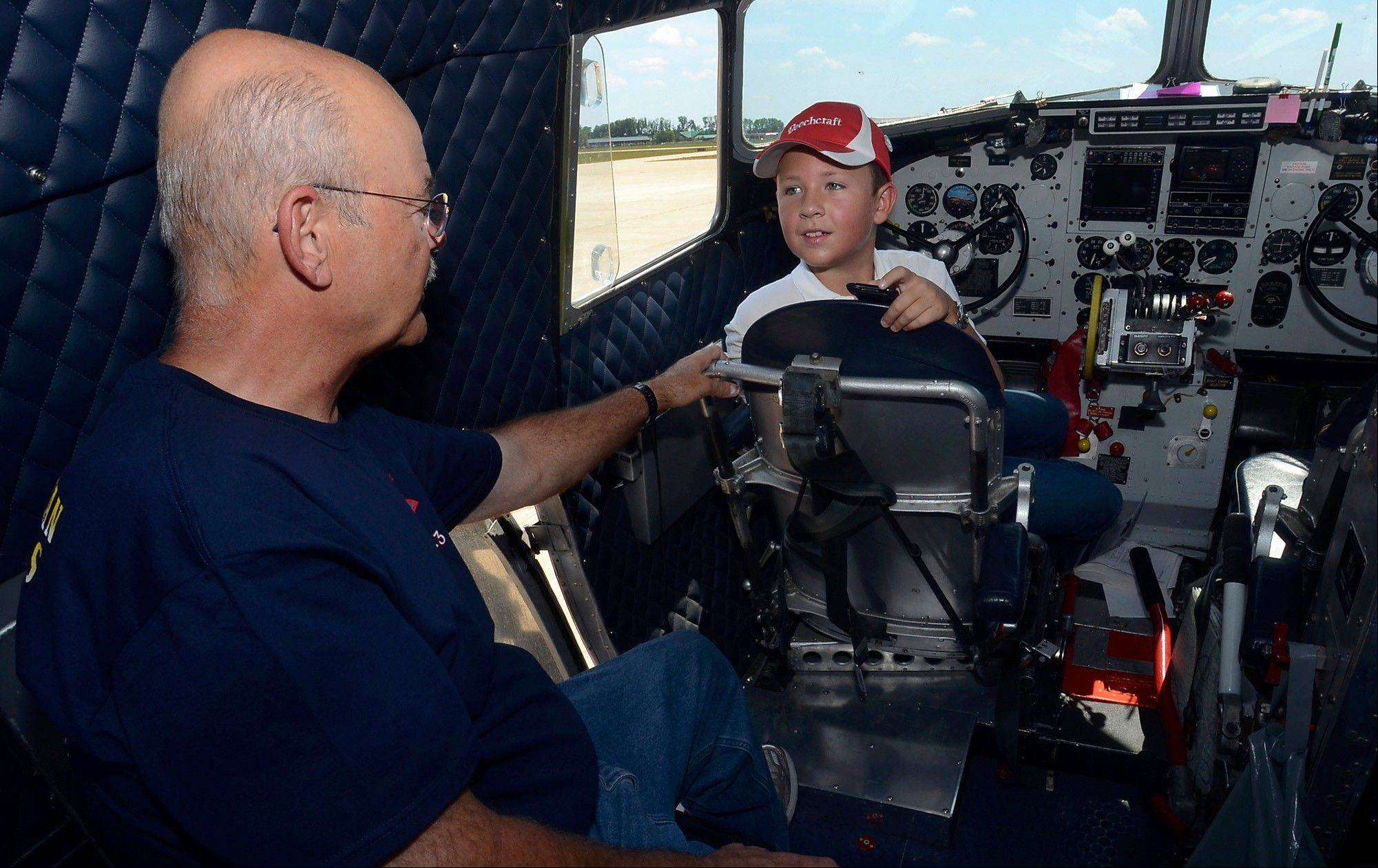 Associated Press/Tribune-Star, Joseph C. Garza Jordan Brown of Terre Haute, Ind., sits in the pilot's seat of the DC-3, Flagship Detroit, as he talks to one of the plane's pilots, Rick Smail, on Tuesday at the Terre Haute International Airport-Hulman Field.