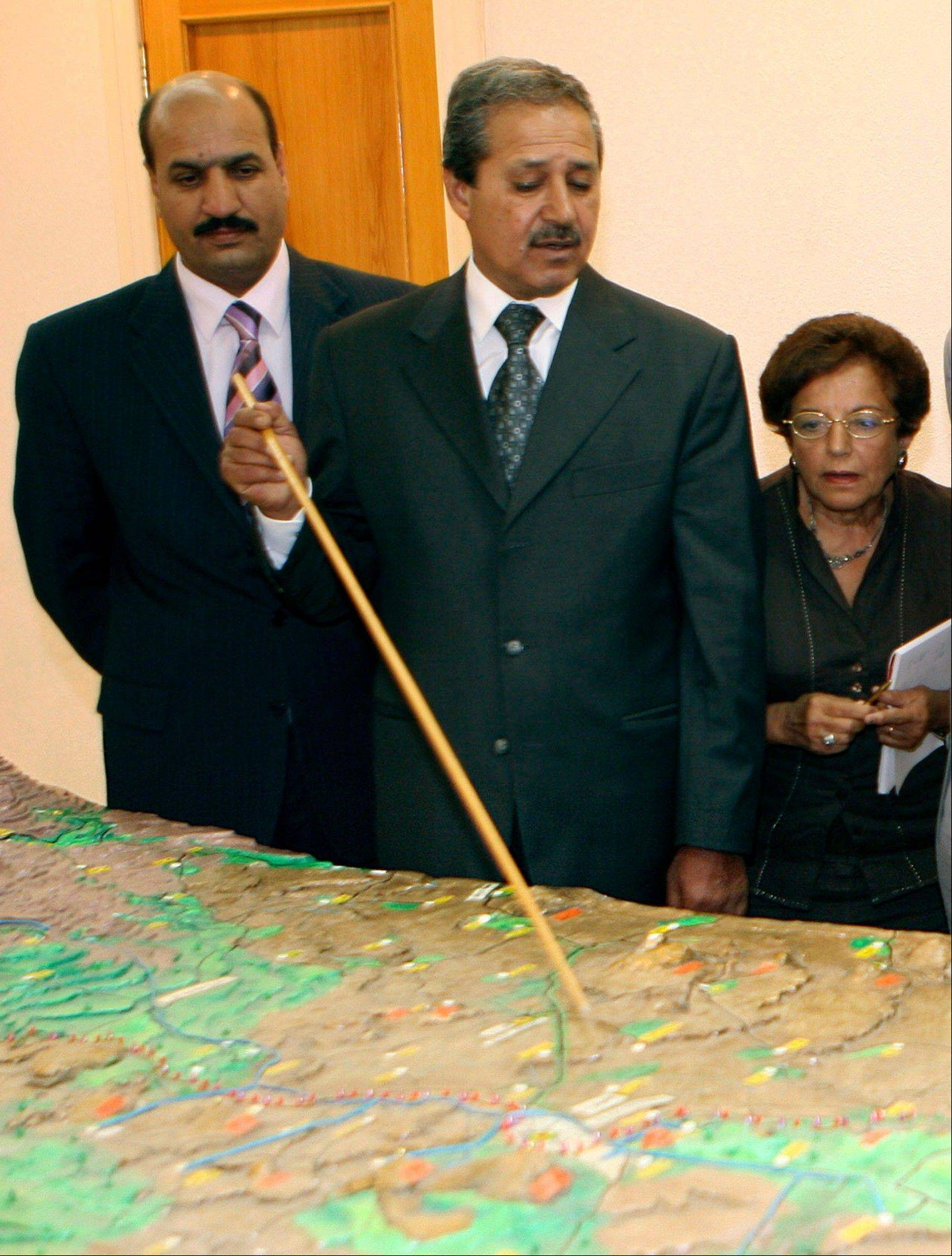 Nawaf Fares, center, governor of the Quneitra, Syria, briefs a U.N. delegation visiting the city of Quneitra in the Golan Heights to investigate Israeli practices in occupied Arab lands. Fares was named Syria�s ambassador to Iraq in September, 2008, and became the highest ranking diplomat to defect from President Bashar Assad�s regime on Wednesday. He dismissed the main international plan seeking to stop the violence in his country, saying Thursday that nothing short of Assad�s ouster is acceptable.
