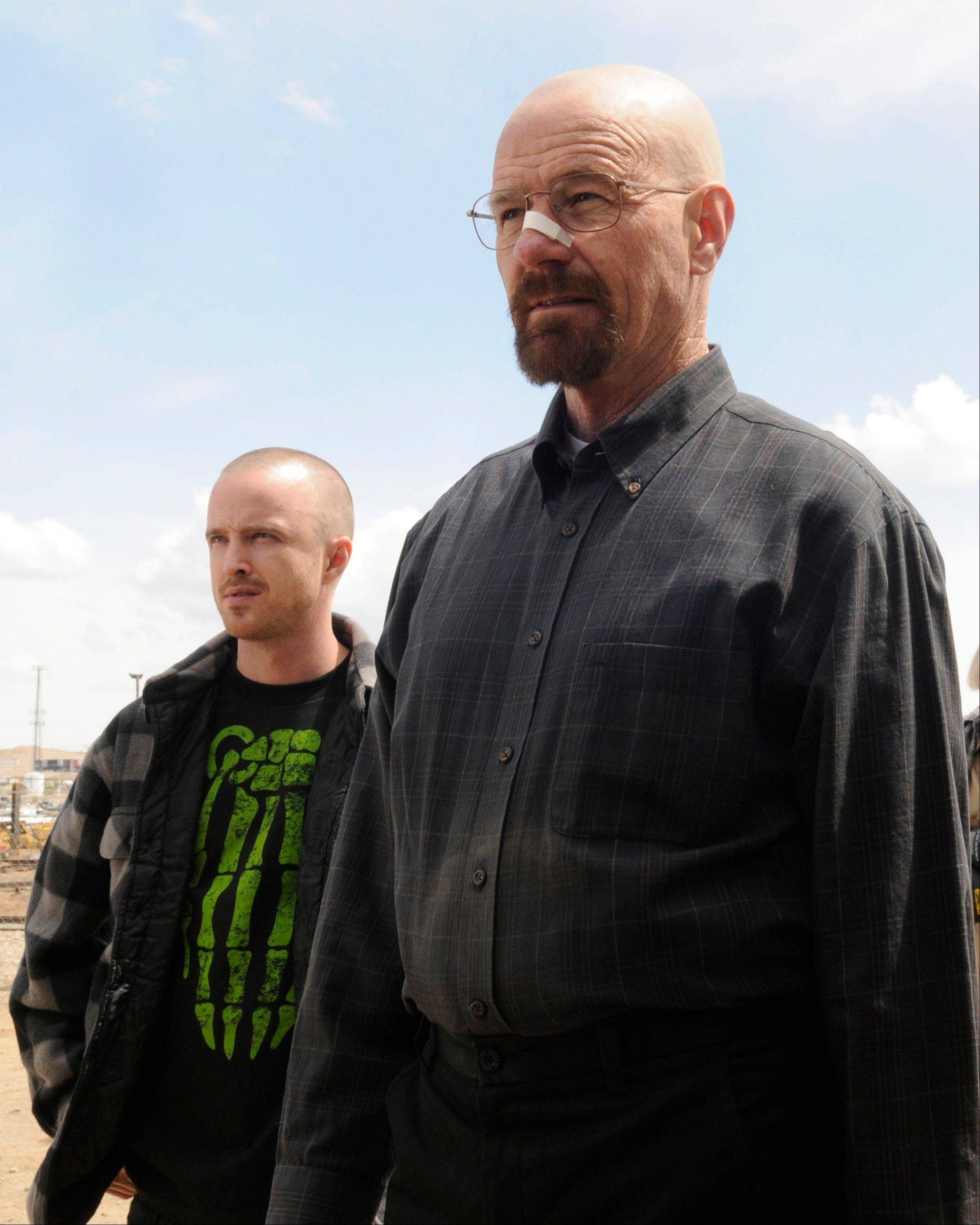 "Walter White (Bryan Cranston), right, and Jesse Pinkman (Aaron Paul) return in season 5 of AMC's ""Breaking Bad,"" airing Sunday, July 15."