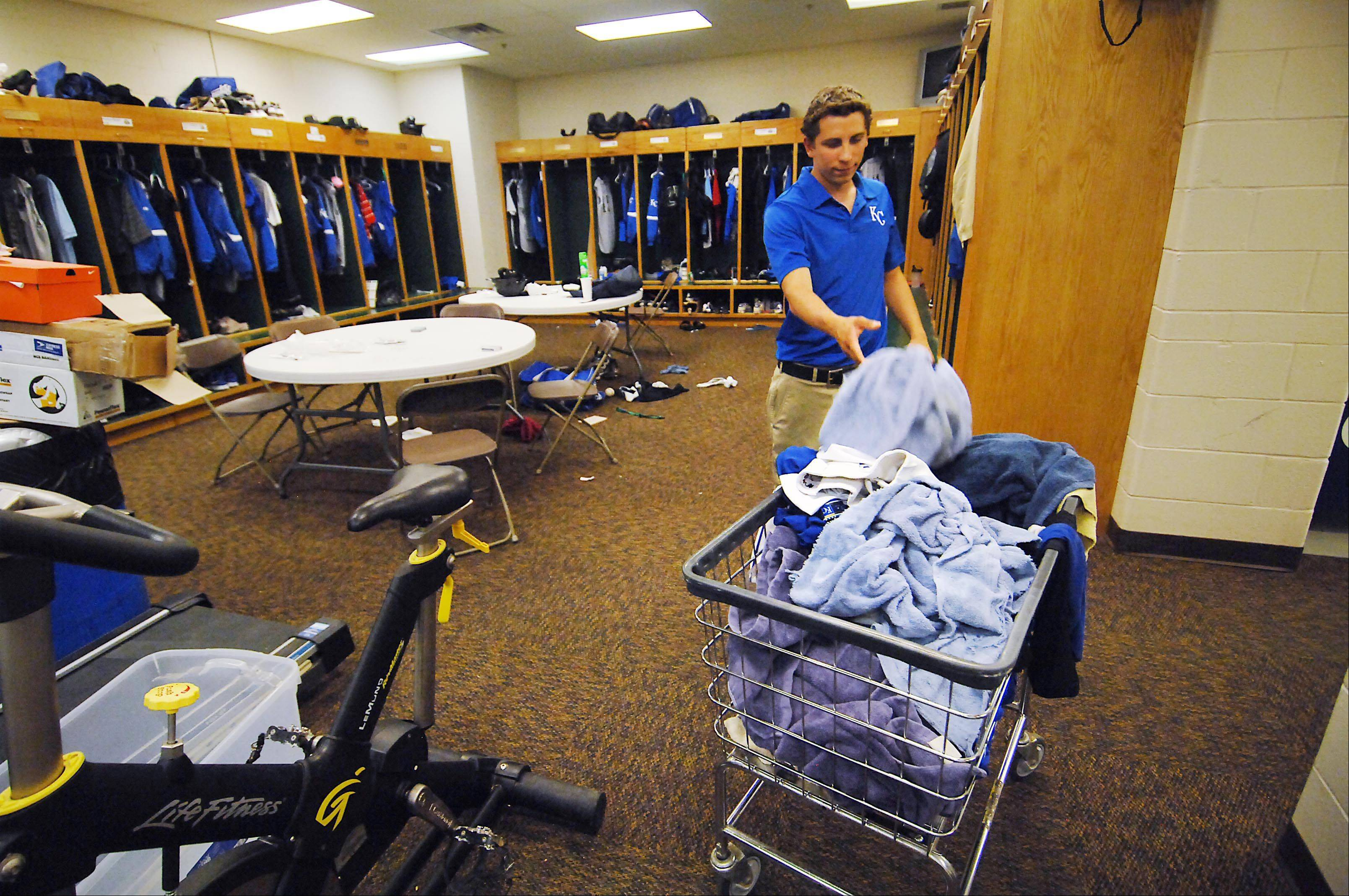 Picking up dirty towels and uniforms in the clubhouse is an ongoing job before, during and after each game at Fifth Third Bank Ballpark in Geneva.