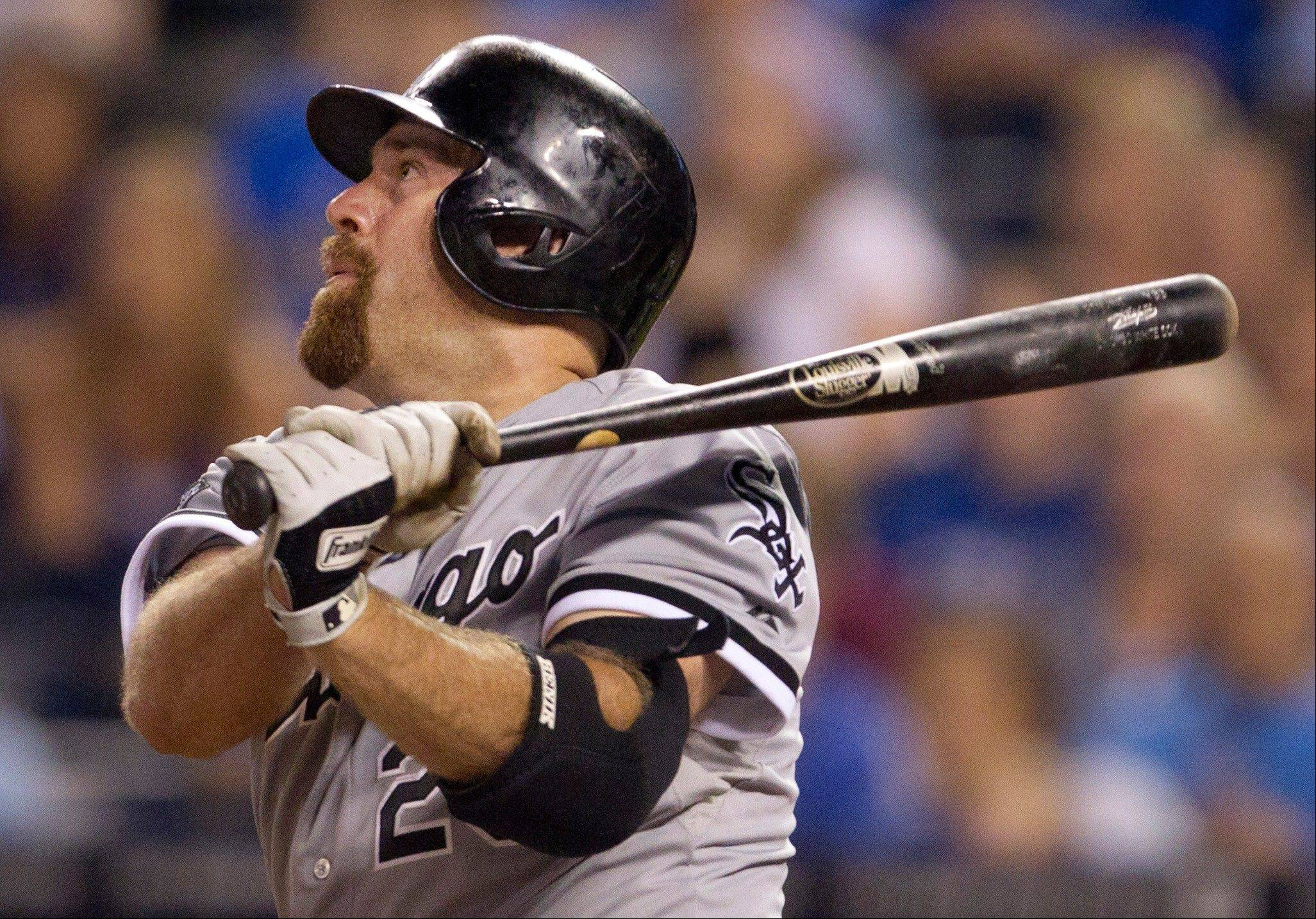 Kevin Youkilis hits the game-winning sacrifice fly in the 14th inning early Saturday in Kansas City, Mo. The White Sox defeated the Royals 9-8.