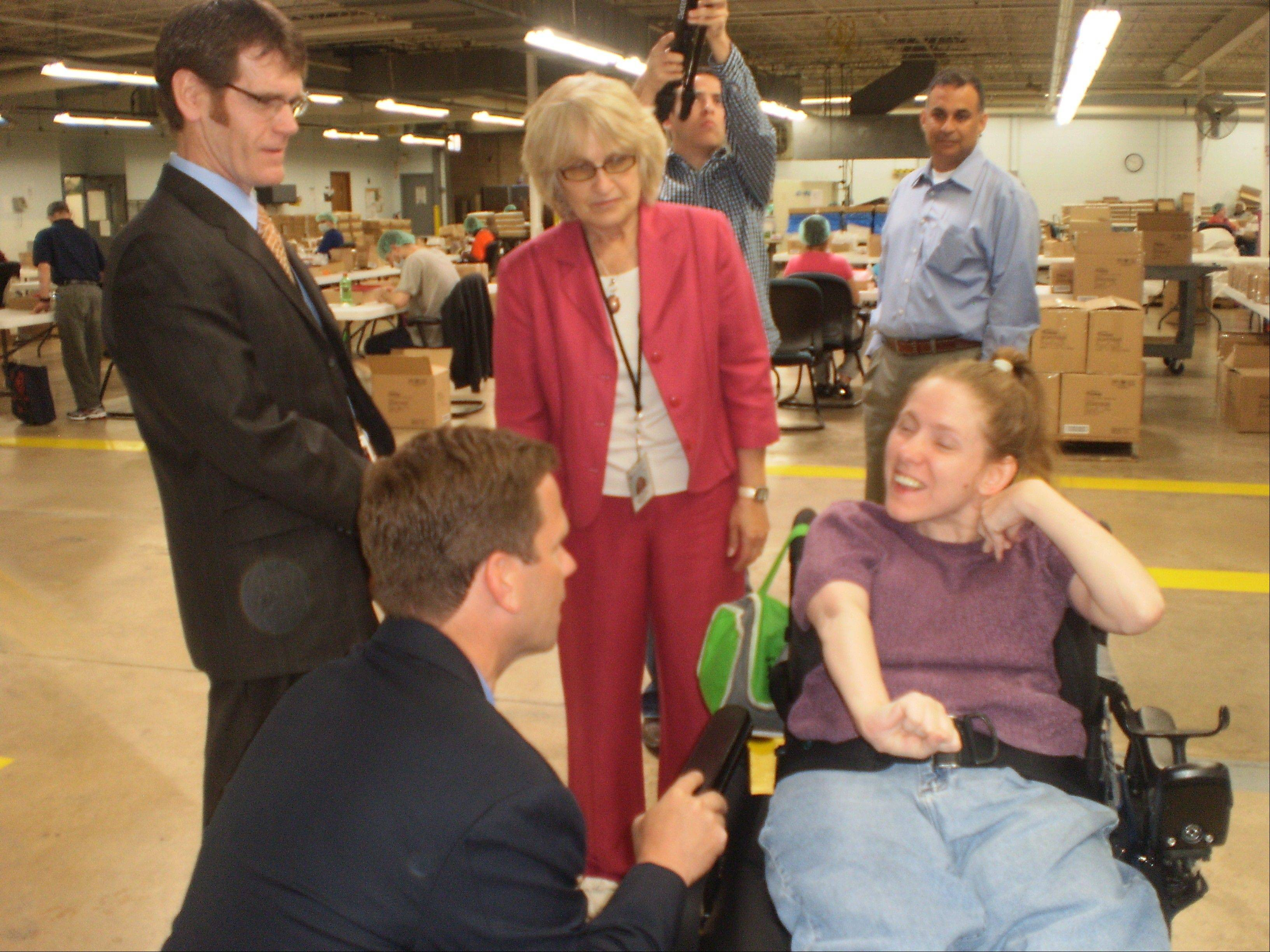 U.S. Rep. Robert Dold speaks with Heather, who receives living and day services from NorthPointe Resources and is enrolled at the College of Lake County.