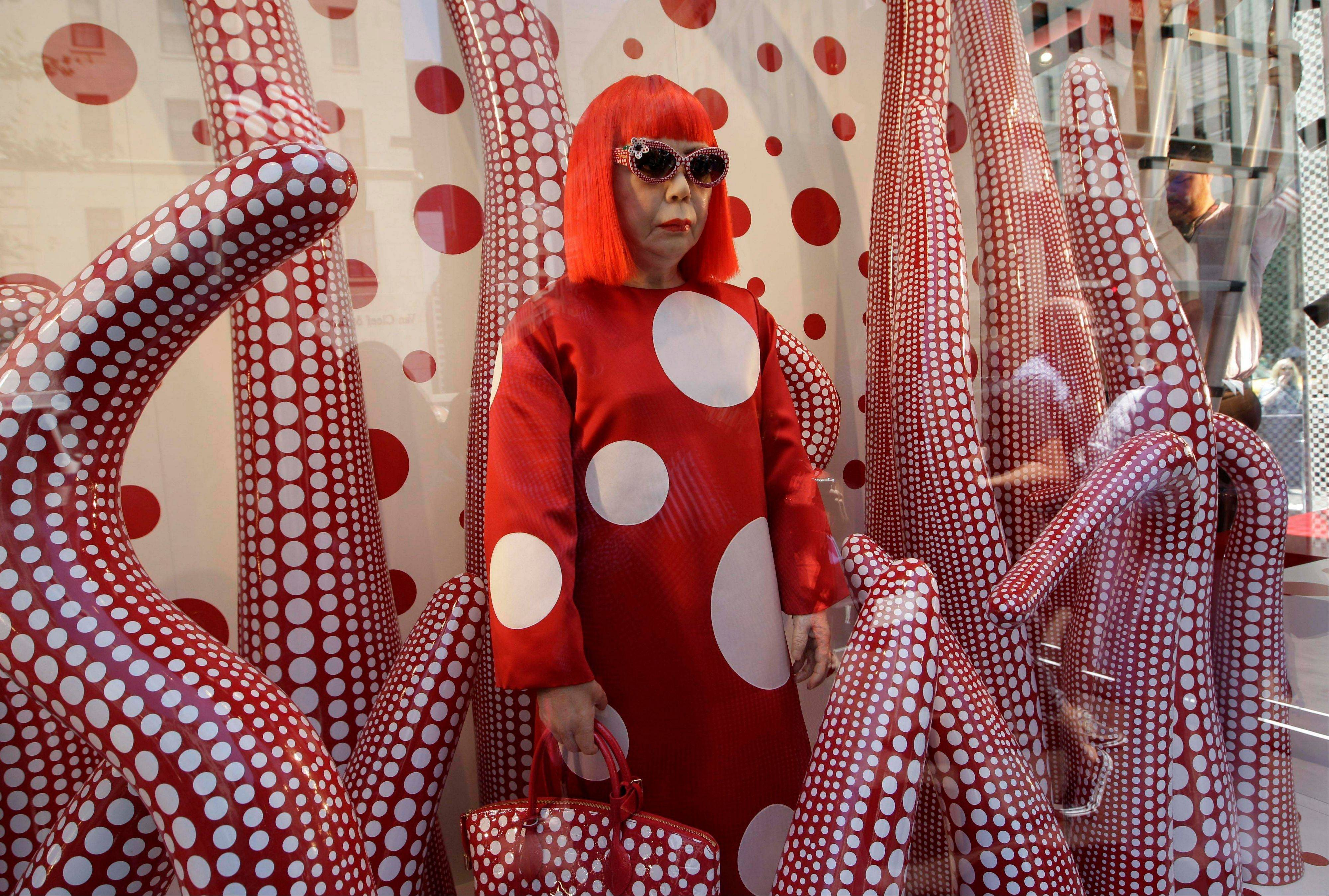 A wax model of Japanese artist Yayoi Kusama is displayed in the windows of Louis Vuitton's flagship Fifth Avenue store in New York on Tuesday, part of a collaborative collection by Kusama and Vuitton creative director Marc Jacobs.