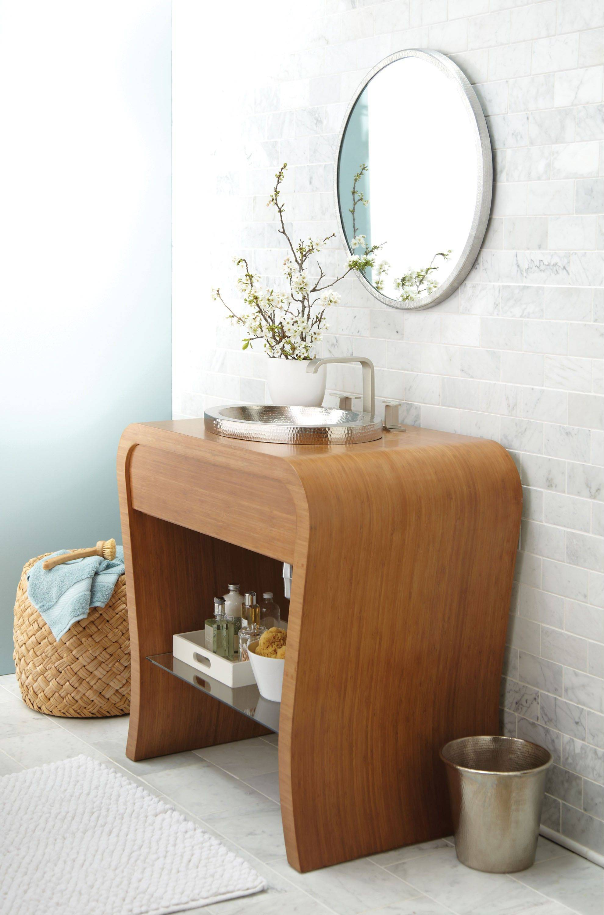 Vessel sinks sit on top of the counter and come in all materials and shapes. This Native Trails vanity features a stainless steel vessel that contrasts with the bamboo base with glass shelf.