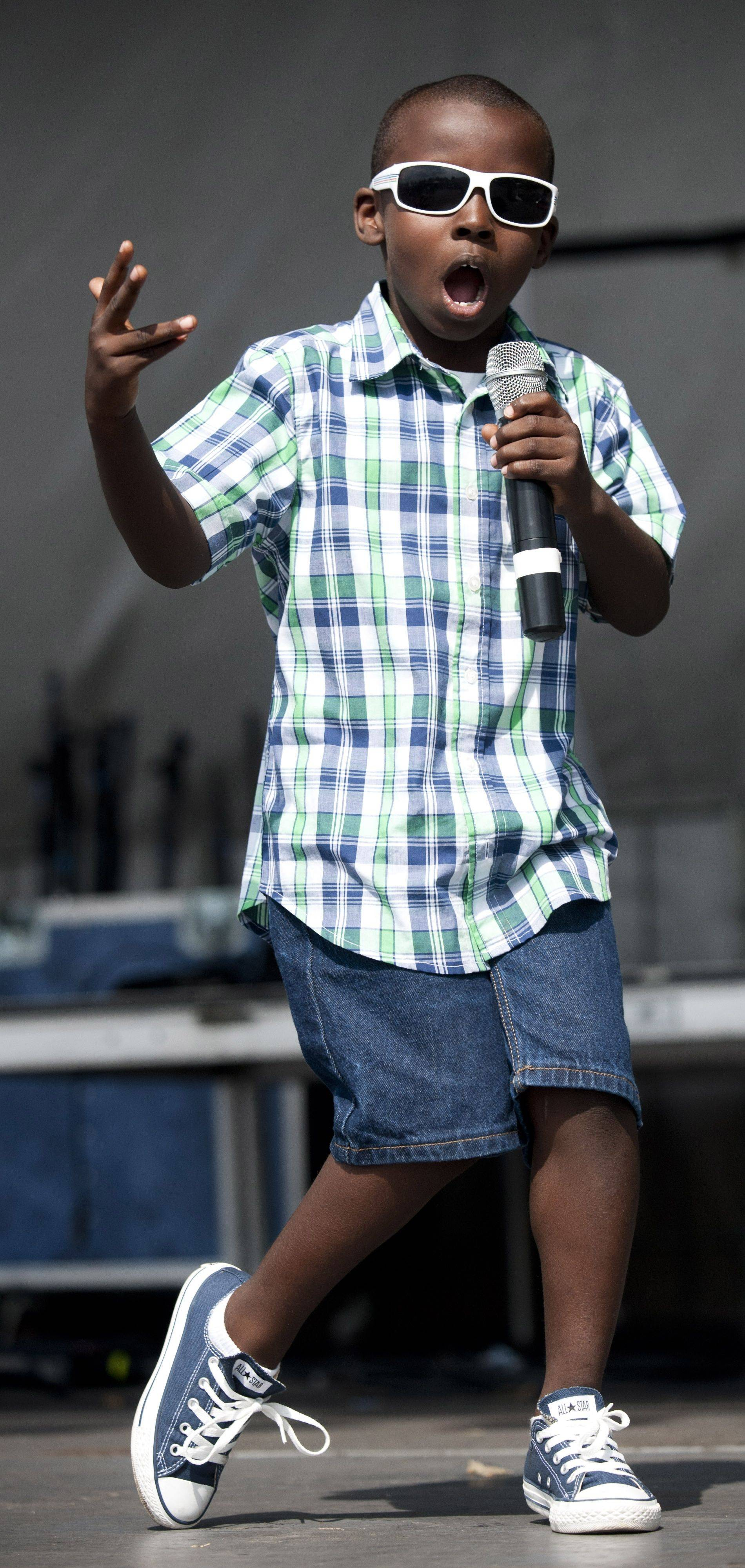 "Ryan Williams, 7, competes in the ""Glendale Idol"" during the Glendale Heights Festival on Saturday."