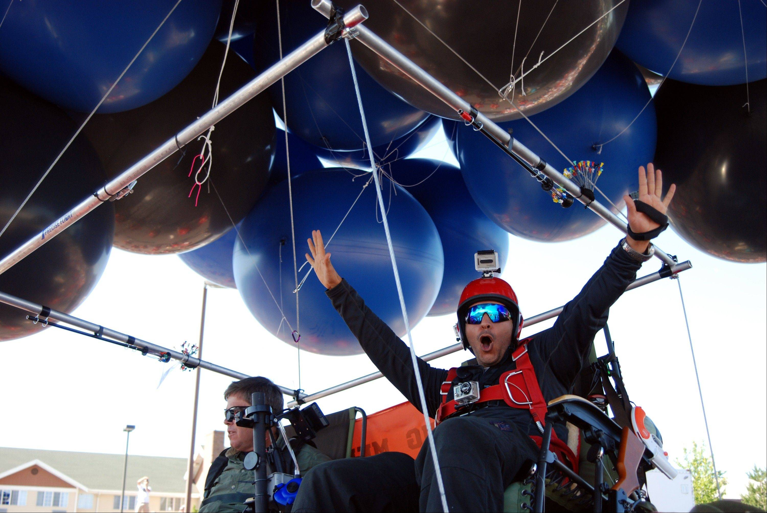 Iraqi adventurer Fareed Lafta, right, and Bend, Ore., gas station owner Kent Couch lift off Saturday from Couch's gas station in Bend, Ore., as they attempt to fly some 360 miles to Montana.