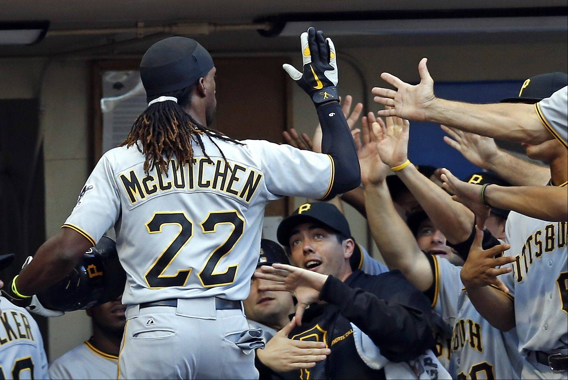 Pittsburgh Pirates outfielder Andrew McCutchen is greeted by his teammates at the dugout Saturday after he hit a two-run home run off Milwaukee Brewers pitcher Marco Estrada during the third inning in Milwaukee.