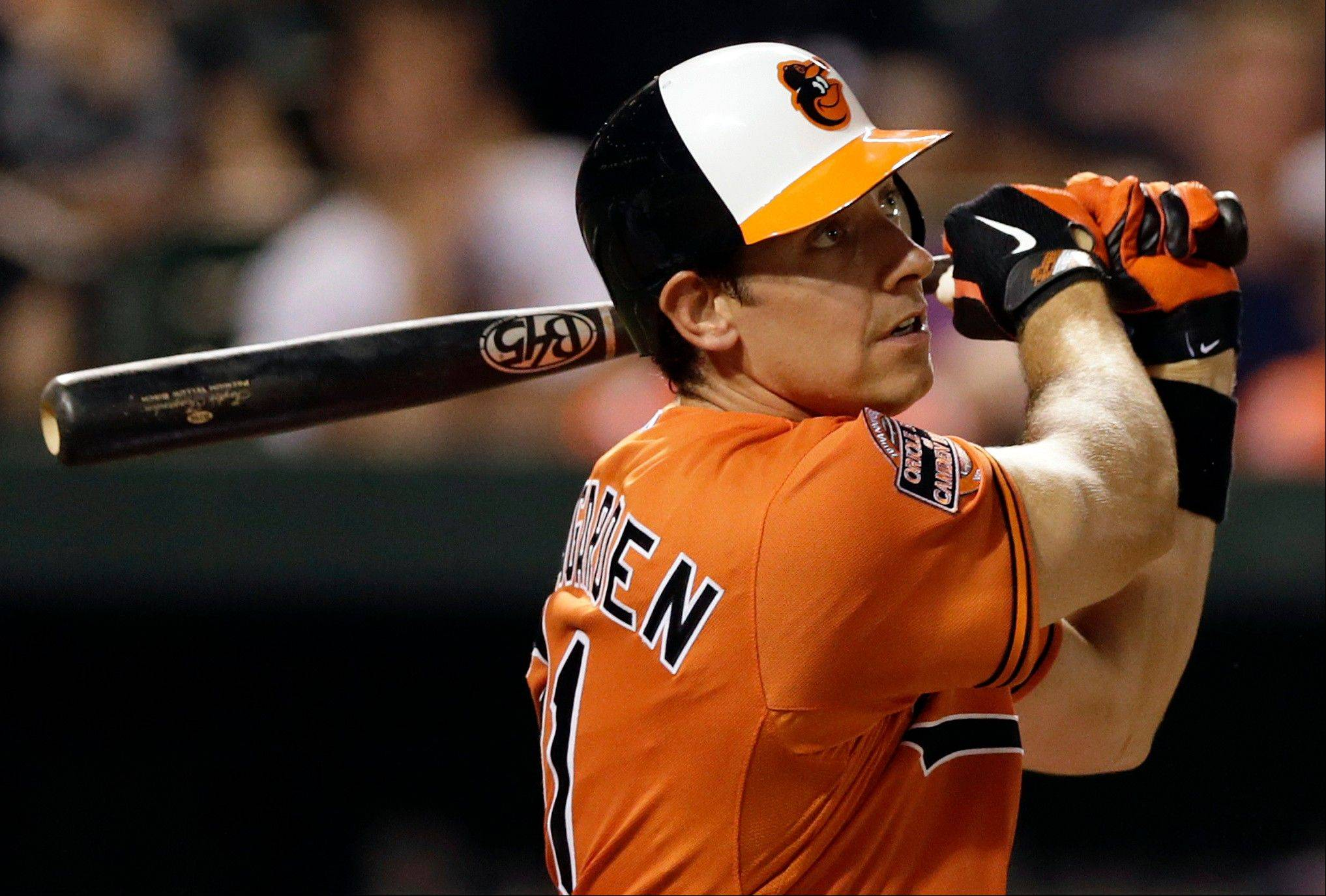 The Baltimore Orioles' Taylor Teagarden watches his 2-run, game-winning home run Saturday during the 13th inning against the Detroit Tigers in Baltimore. Baltimore won 8-6.