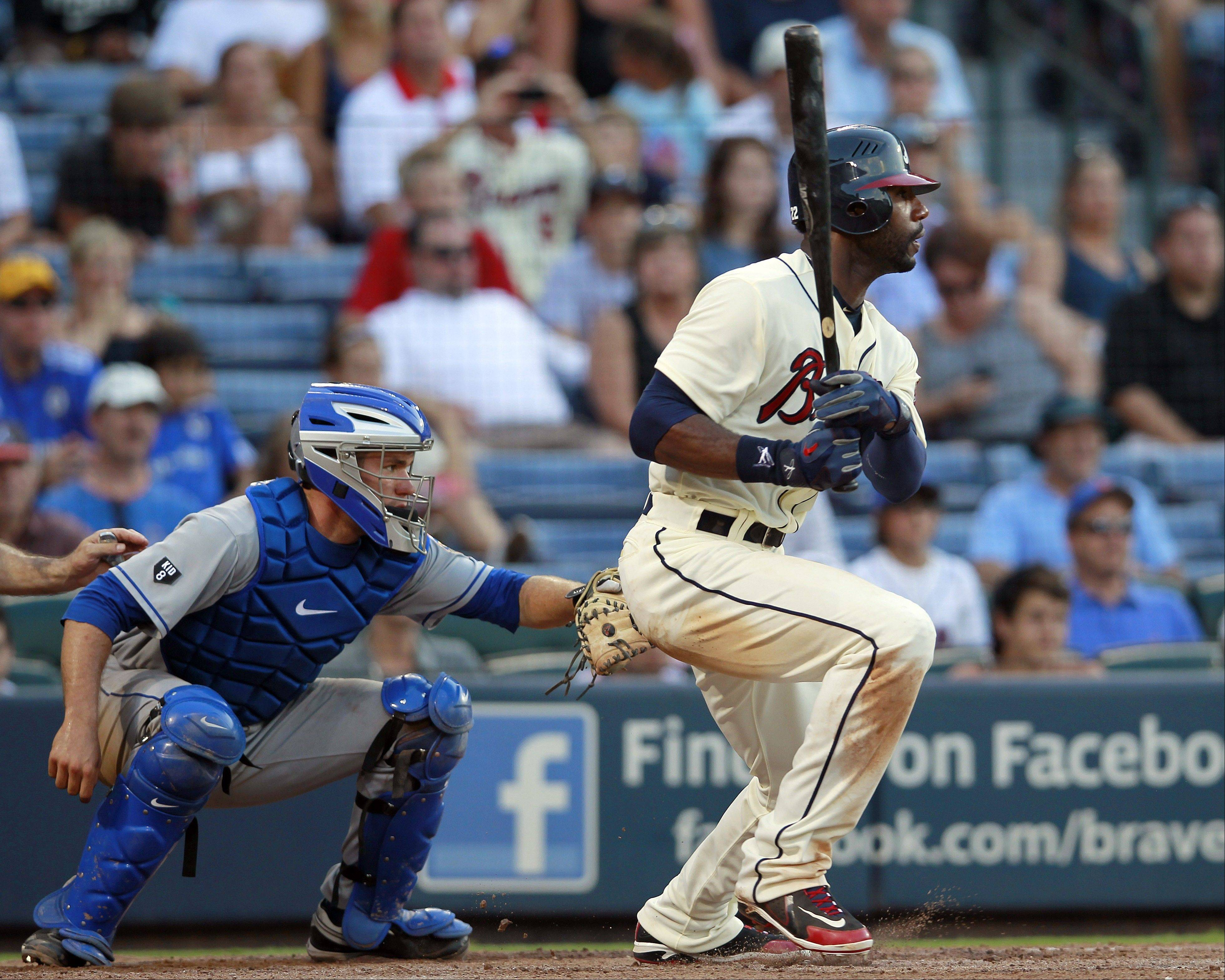 Atlanta Braves right fielder Jason Heyward follows through with an RBI single to give the Braves the lead Saturday during the eighth inning in Atlanta. New York Mets catcher Josh Thole looks on. Atlanta held on to win 8-7.