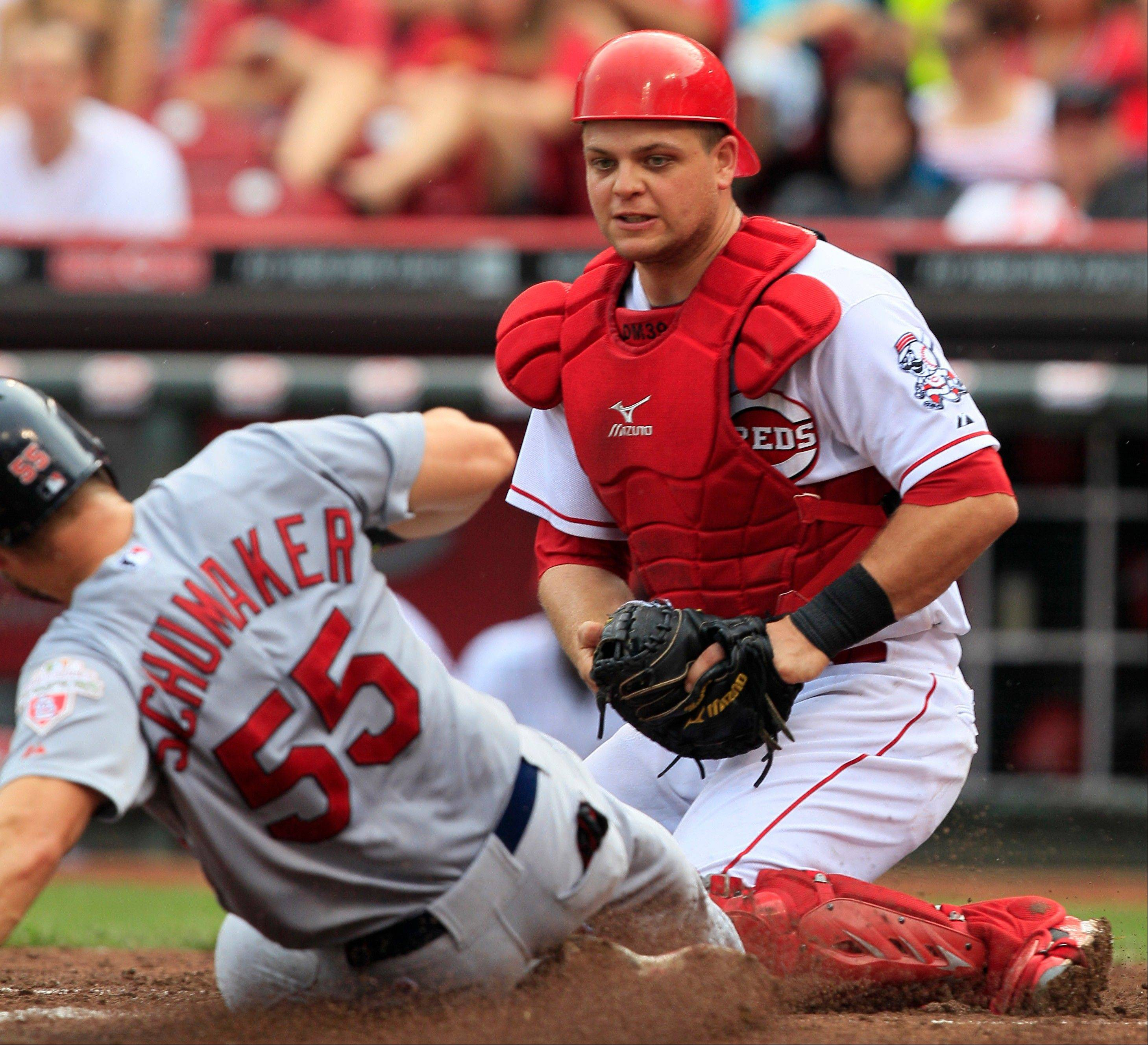 Cincinnati Reds catcher Devin Mesoraco tags out the St. Louis Cardinals' Skip Schumaker at home Saturday during the seventh inning in Cincinnati. Cincinnati won 3-2 in 10 innings.