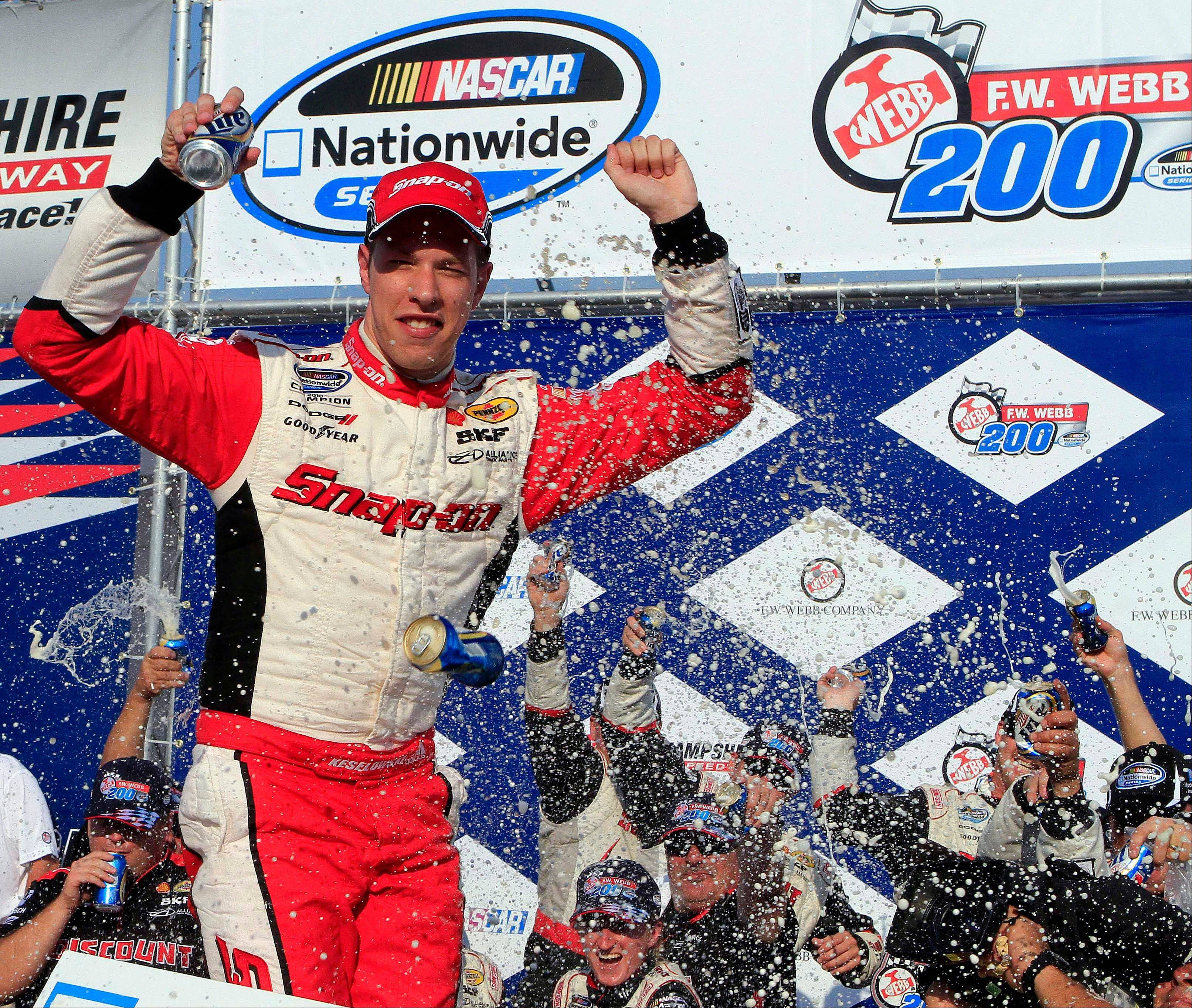 Brad Keselowski celebrates in victory lane after Saturday winning the NASCAR Nationwide Series auto race at New Hampshire Motor Speedway in Loudon, N.H.