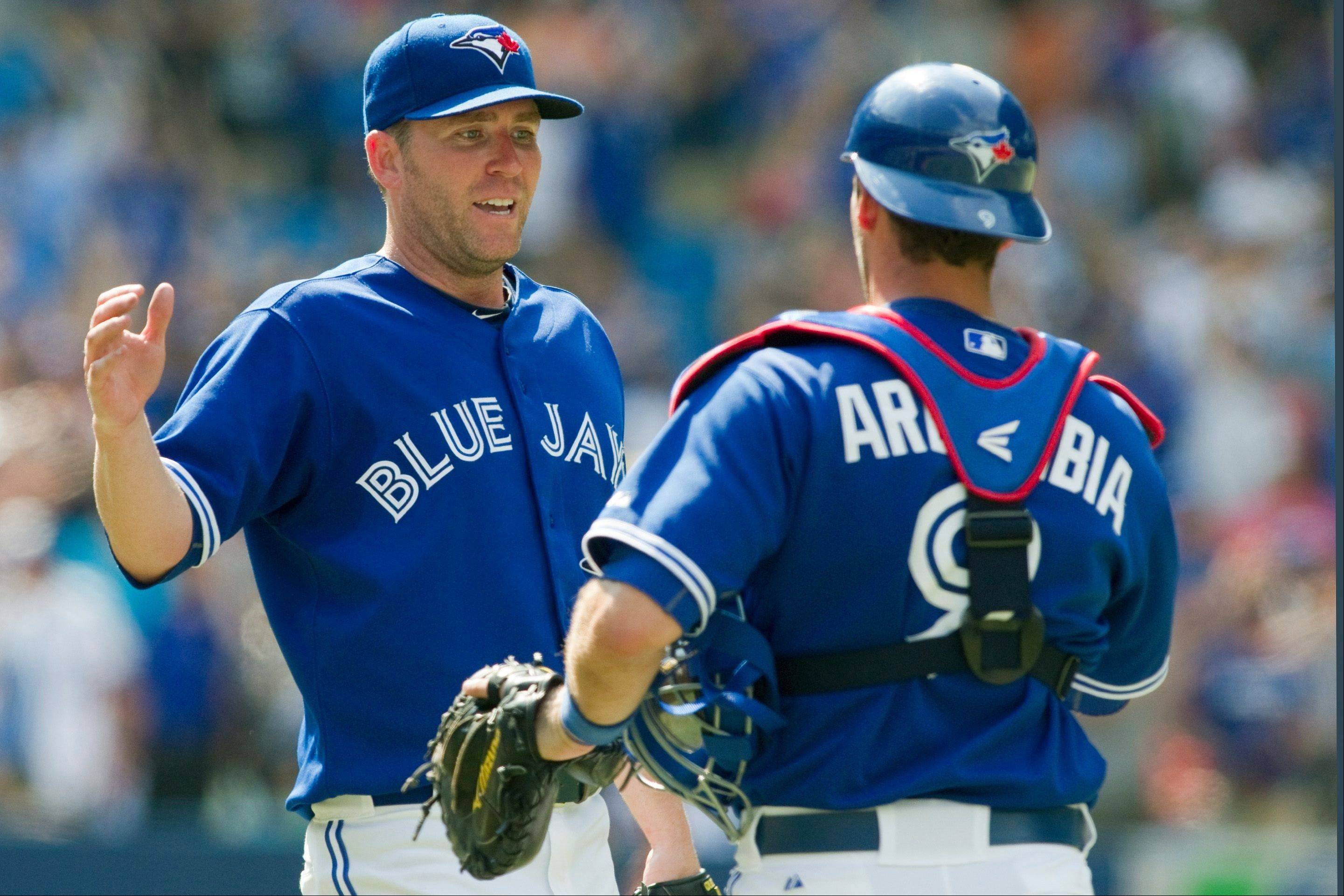 Toronto Blue Jays closer Casey Janssen, left, is congratulated by catcher J.P. Arencibia Saturday after defeating the Cleveland Indians 11-9 in Toronto.