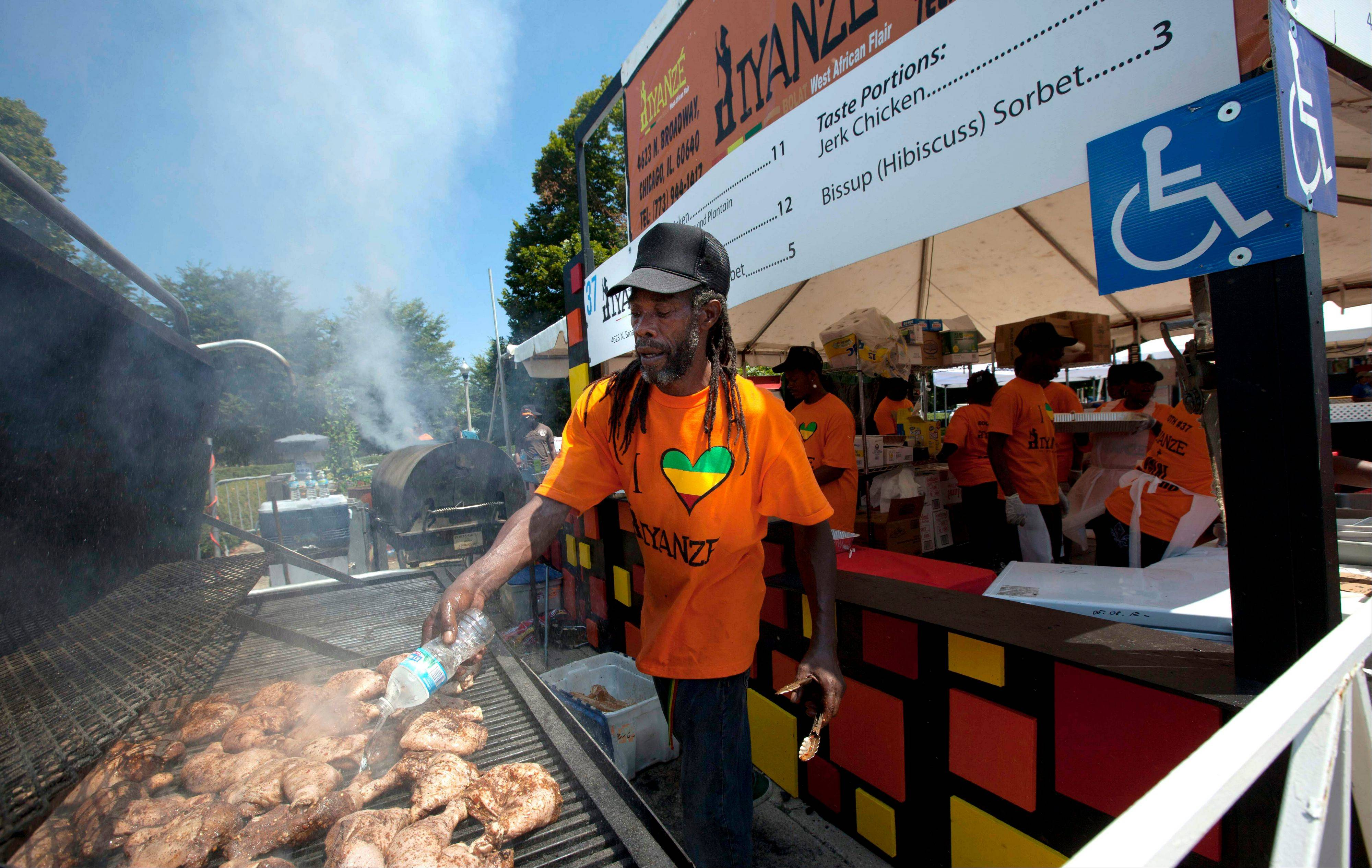 A vendor barbecues chicken Wednesday at the Taste of Chicago.