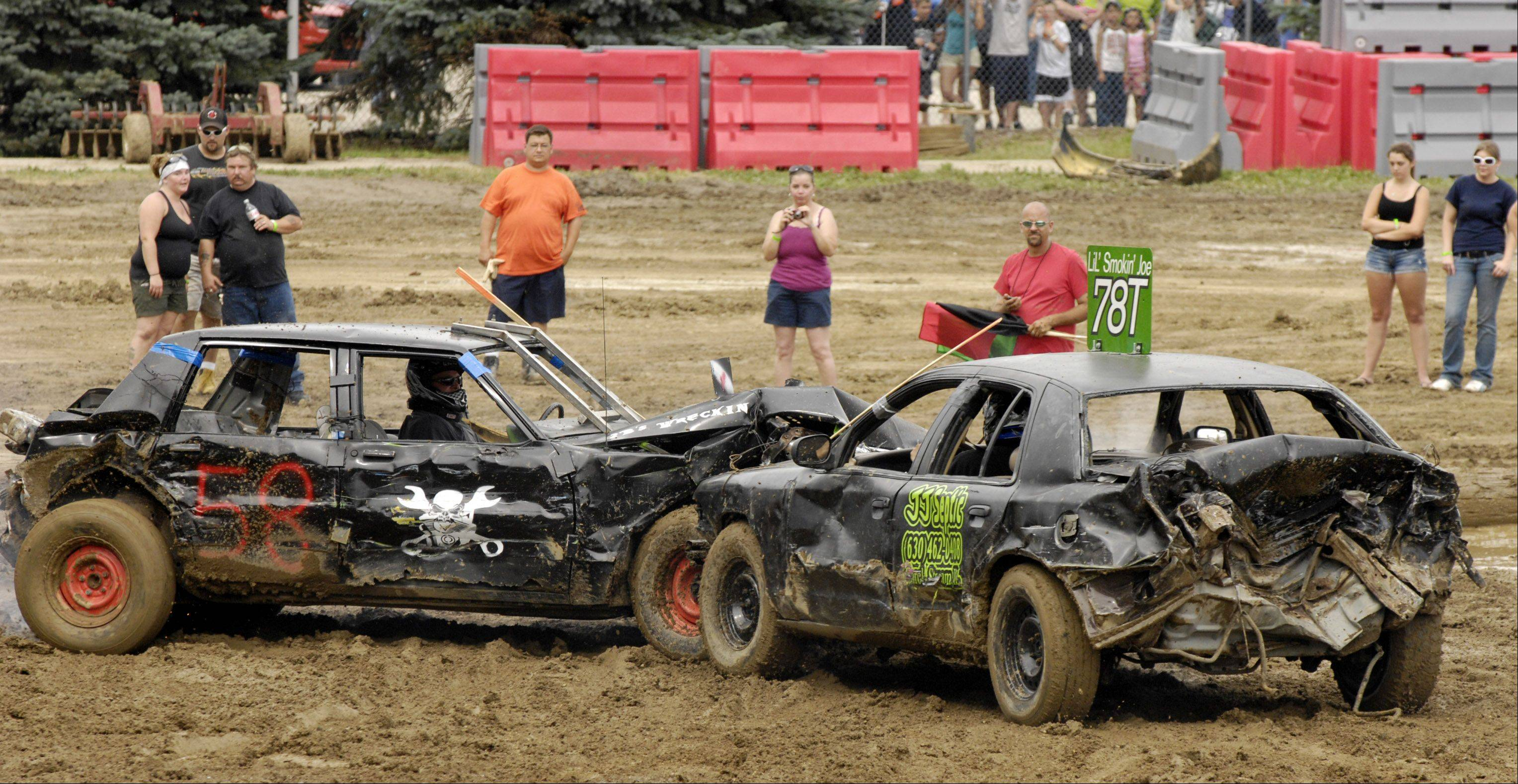Brian Ellingsworth of Plainfield and Joseph Jackson of Carol Stream battle it out for first place in the demolition derby on the final day of the 2011 Kane County Fair. Jackson of JJ Septic in Carol Stream won the derby.
