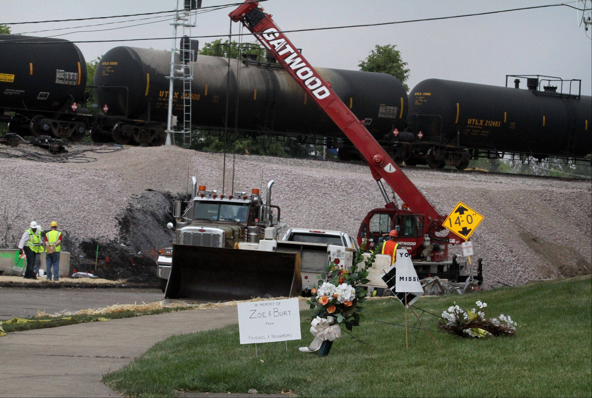 Work continued in Glenview Friday at the site of the July 4 train derailment that collapsed the railroad viaduct at Shermer Road. Union Pacific Railroad poured a temporary gravel bridge with tracks running over it until the bridge can be rebuilt.