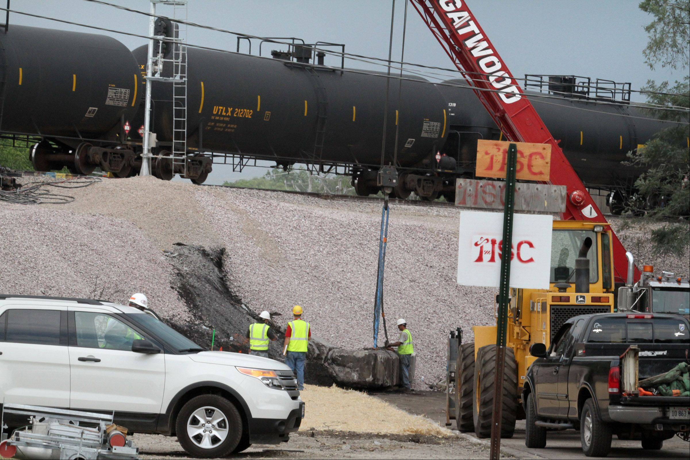 Work continued in Glenview Friday where the railroad bridge over Shermer Road in Glenview collapsed following a Union Pacific train derailment on July 4.