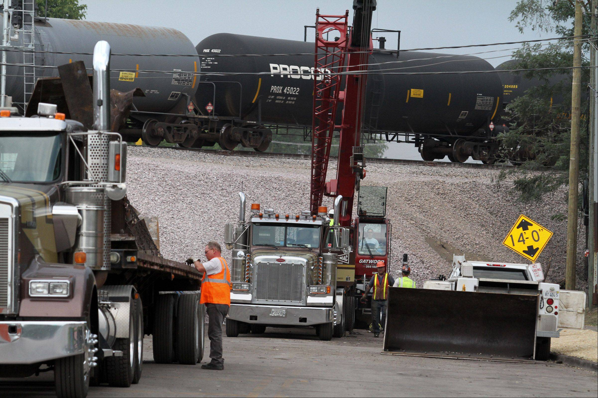 Crews continue cleanup of the train derailment site in Glenview Friday.