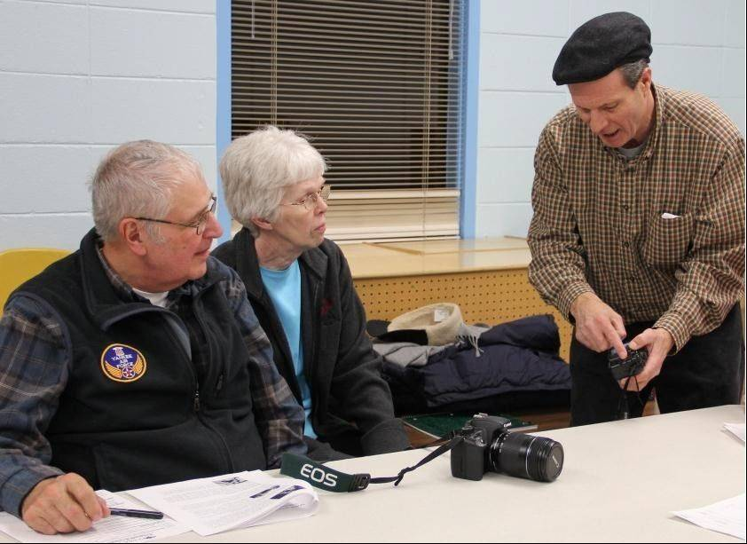 The Schaumburg Park District will offer two photography classes this summer at Bock Neighborhood Center taught by Daily Herald photojournalist George LeClaire, pictured working with participants of a previous class. For information, visit parkfun.com.