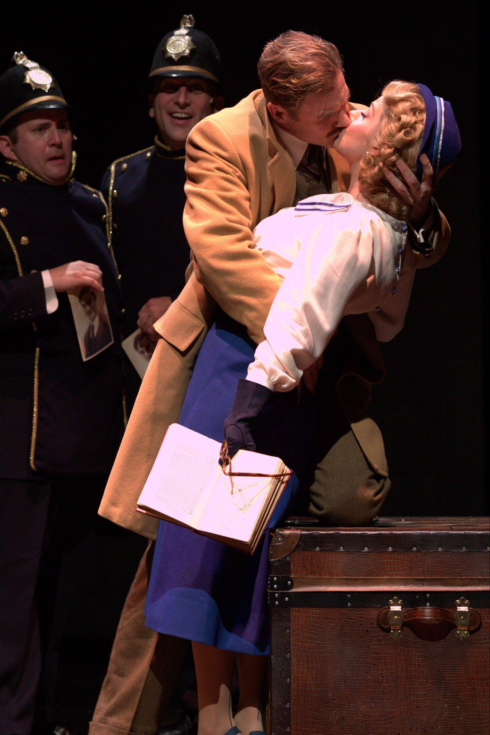 "Man-on-the-run Richard Hannay (Peter Simon Hilton, second from right) surprises Pamela (Angela Ingersoll) with a kiss to avoid detection by the police (Jeff Dumas, left, and Paul Kalina) in David New's highly entertaining revival of ""The 39 Steps"" at Drury Lane Theatre in Oakbrook Terrace."