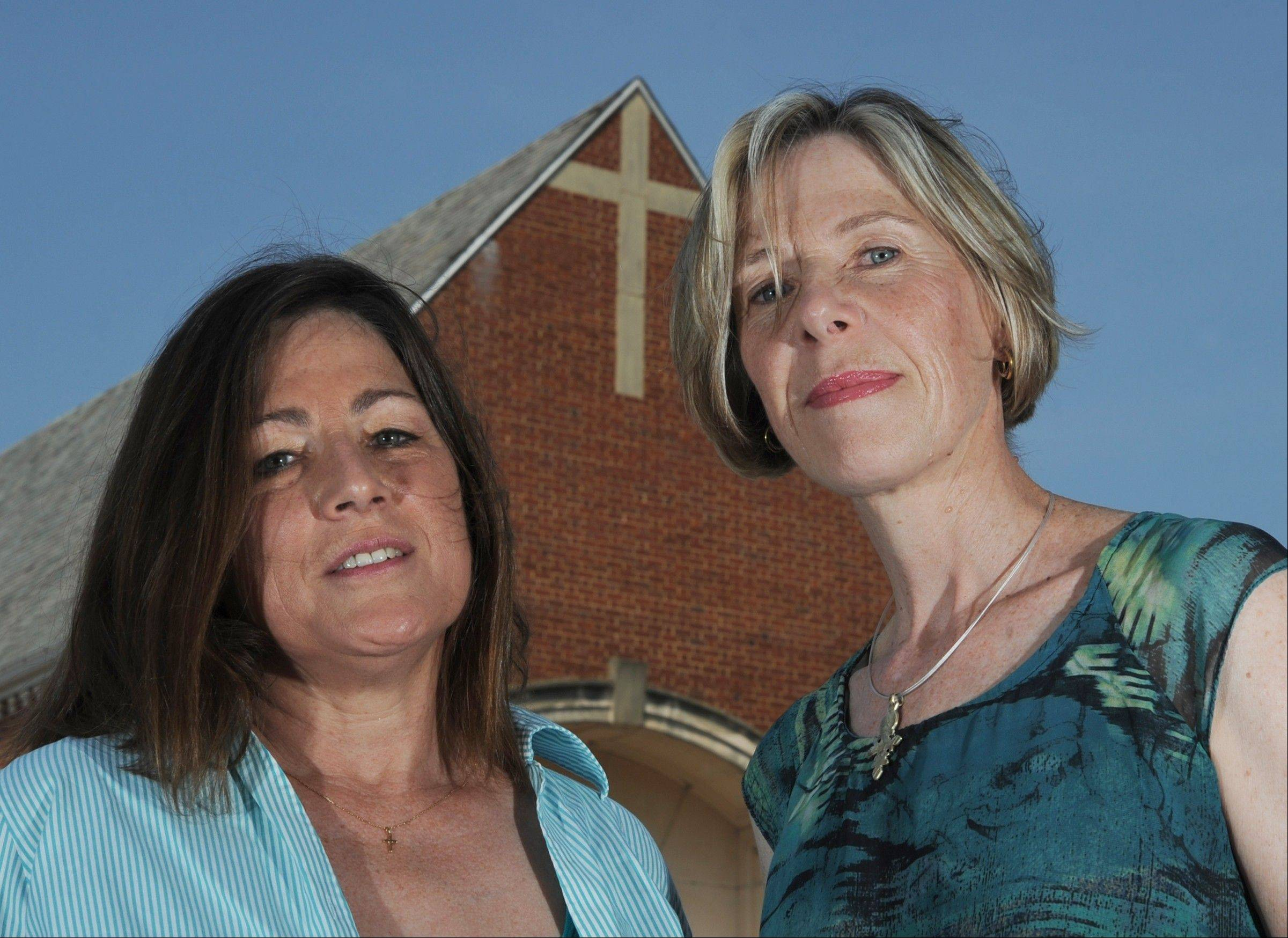 Kathleen Riley, left, and Alison Carroll resigned as teachers at St. Ann Catholic Church in Arlington, Va., explaining they would not sign a new Profession of Faith required by their bishop.