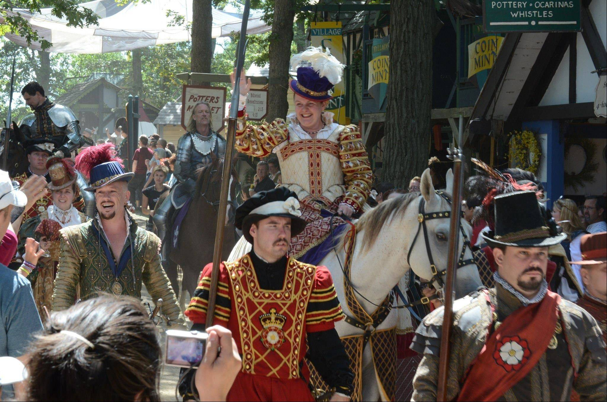The queen greets the crowds during a parade at the Bristol Renaissance Faire.