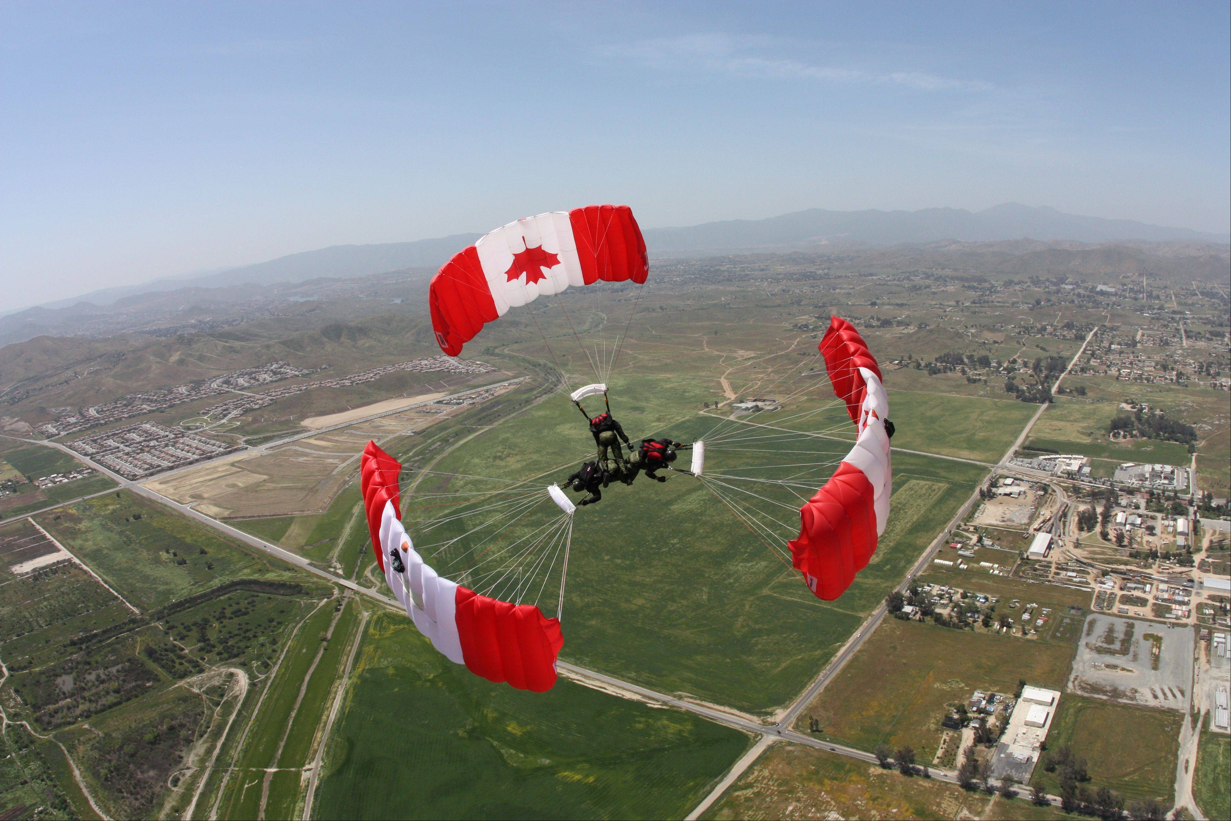 The world-renowned Canadian Skyhawks parachute team will be part of the EAA AirVenture in Oshkosh, Wis.