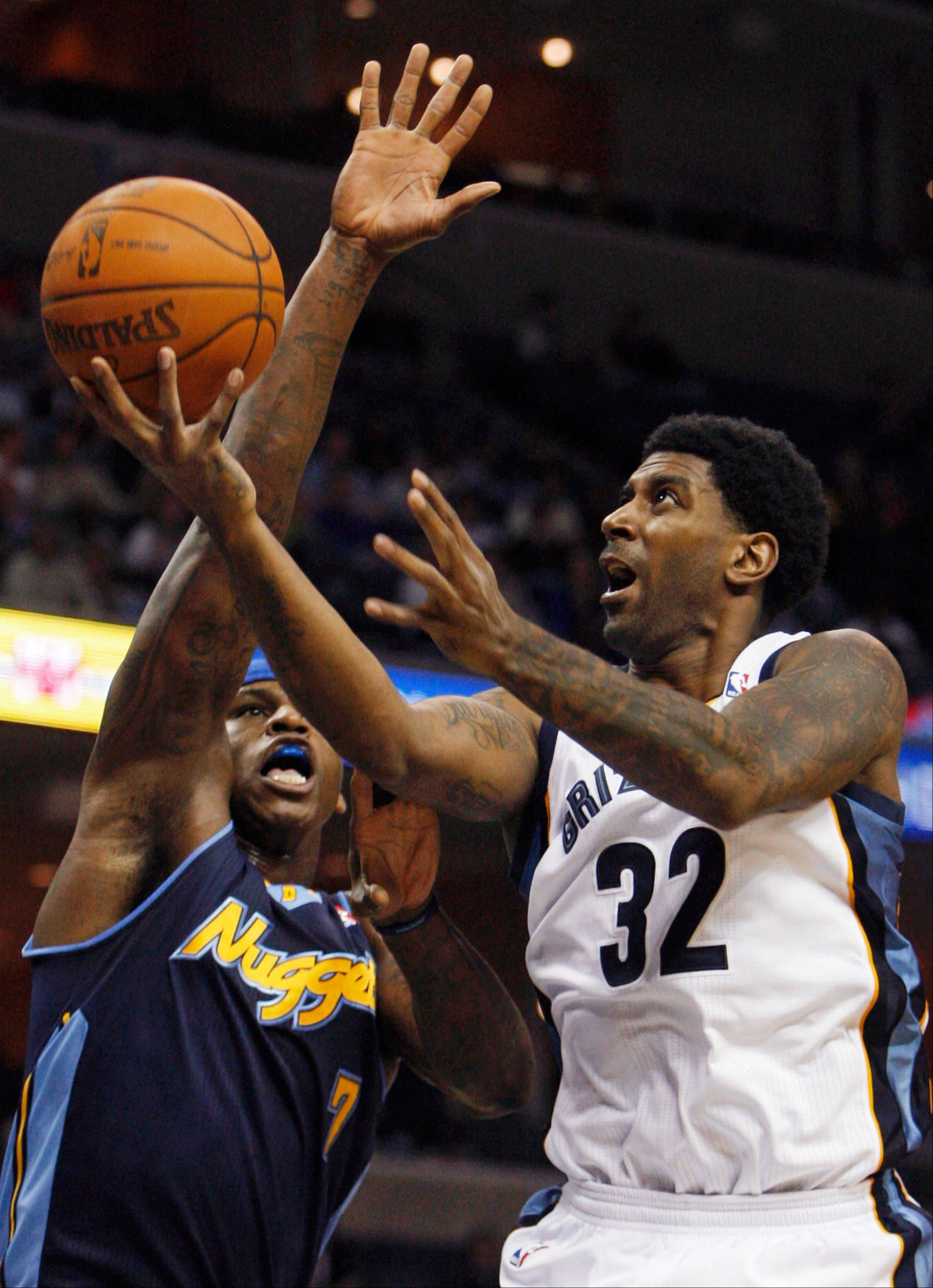 Memphis Grizzlies guard O.J. Mayo (32) heads to the basket as Denver Nuggets forward Al Harrington (7) defends in the second half of an NBA basketball game Tuesday, Jan. 31, 2012, in Memphis, Tenn. The Grizzlies won in overtime 100-97.