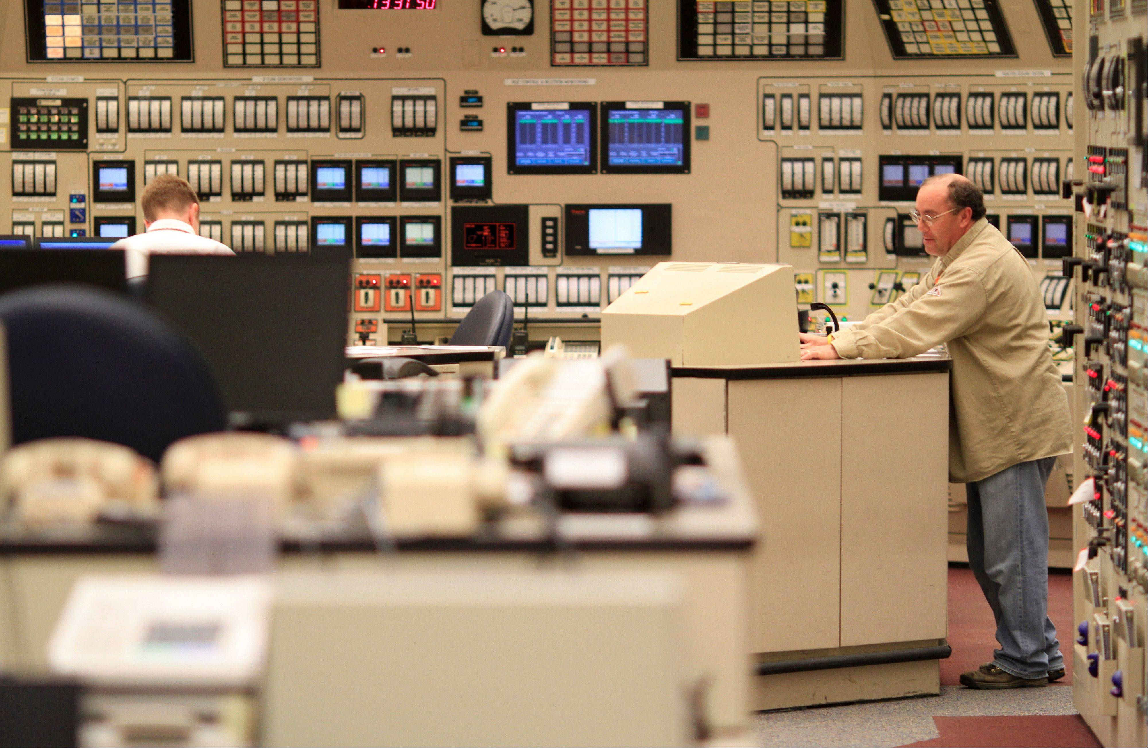 A technician watches a monitor in the Unit 1 control room at Watts Bar Nuclear Power Plant in Spring City, Tenn., on April 5. The Tennessee Valley Authority has concluded that construction of the power plant, initially budgeted for $2.5 billion, is about three years behind schedule and will cost up to $2 billion more. Licensing delay charges, soaring construction expenses and installation glitches have also driven up the costs of nuclear plants in Georgia and South Carolina, according to an Associated Press analysis of public records and regulatory filings.
