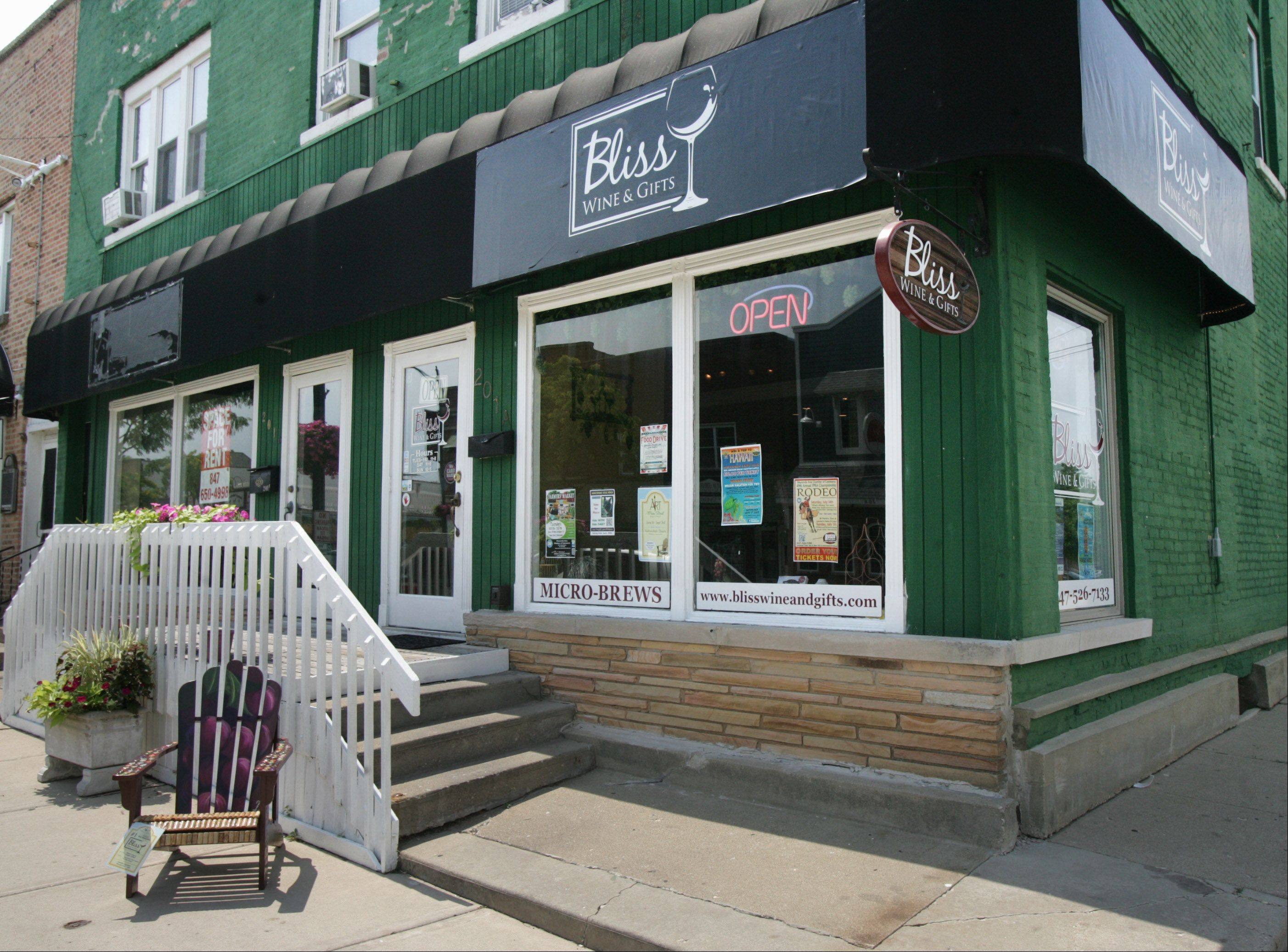Bliss Wine & Gifts offers wine and appetizers and seating to enjoy takeout from nearby restaurants.