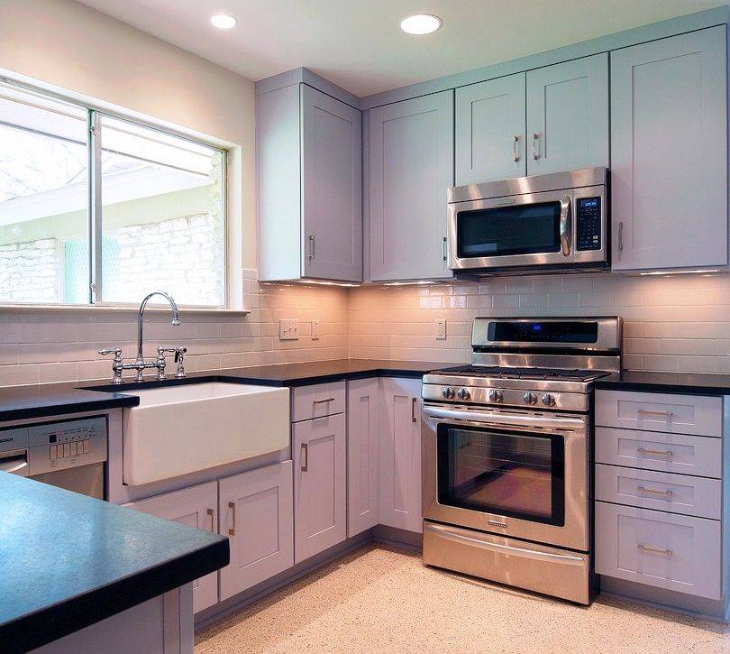Roger Hazard used Custom Cabinets in lavender for a kitchen after noticing the homeowner always wore shades of purple. The island that is not shown is eggplant colored.