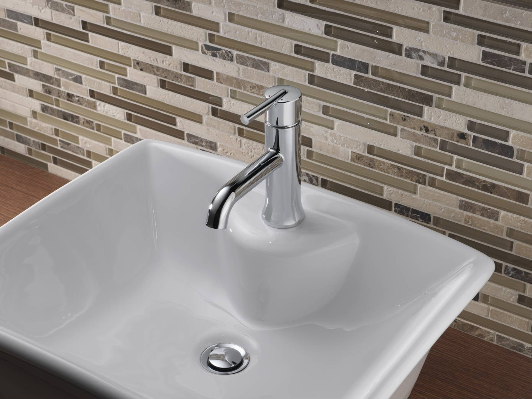 Delta introduces its Trinsic faucet collection for the bathroom, based on its kitchen series.