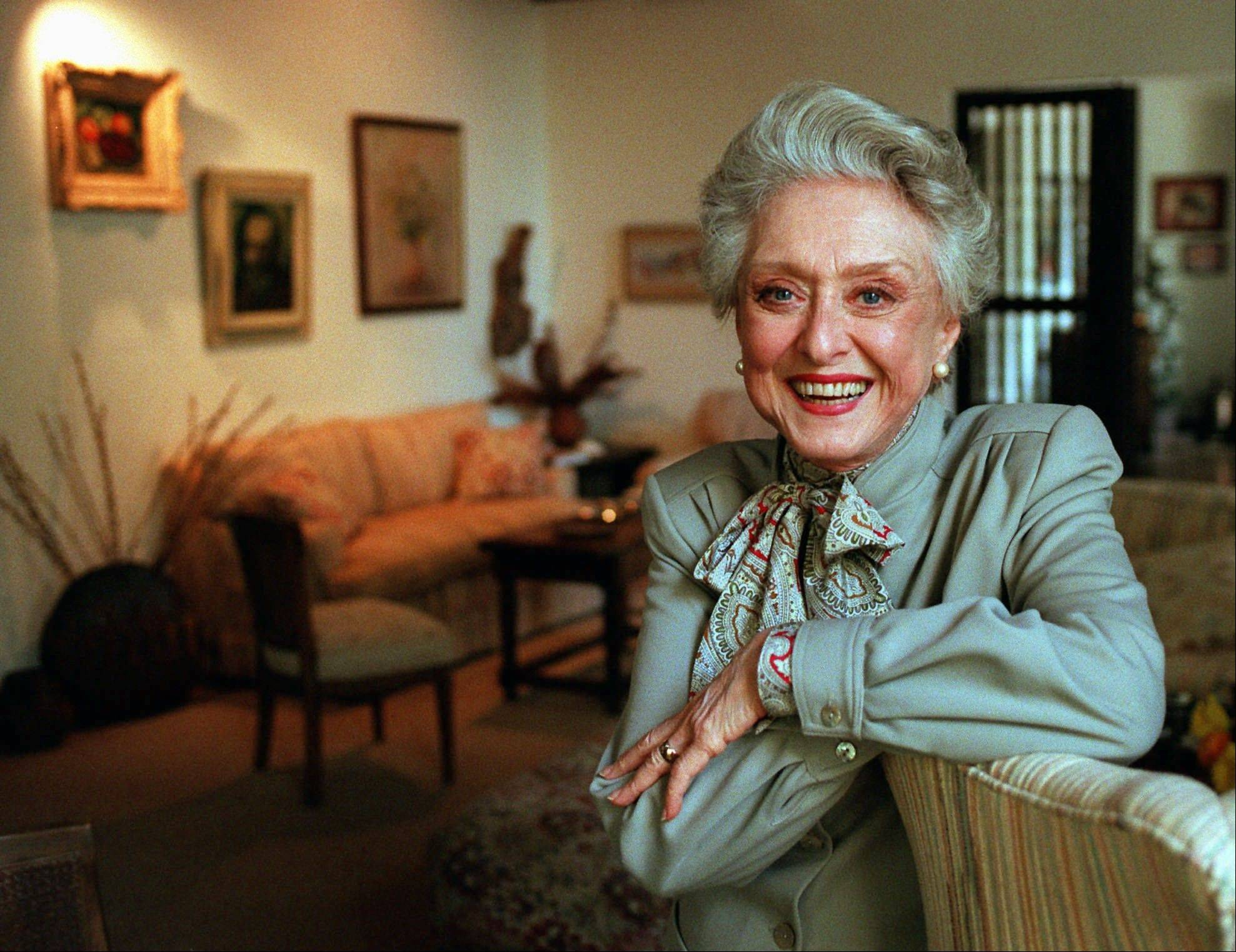 "In this March 12, 1997, file photo, actress Celeste Holm poses at a friends' home in Santa Monica, Calif. Celeste Holm, a versatile, bright-eyed blonde who soared to Broadway fame in ""Oklahoma!"" and won an Oscar in ""Gentlemen's Agreement"" but whose last years were filled with financial difficulty and estrangement from her sons, died Sunday, a relative said. She was 95."