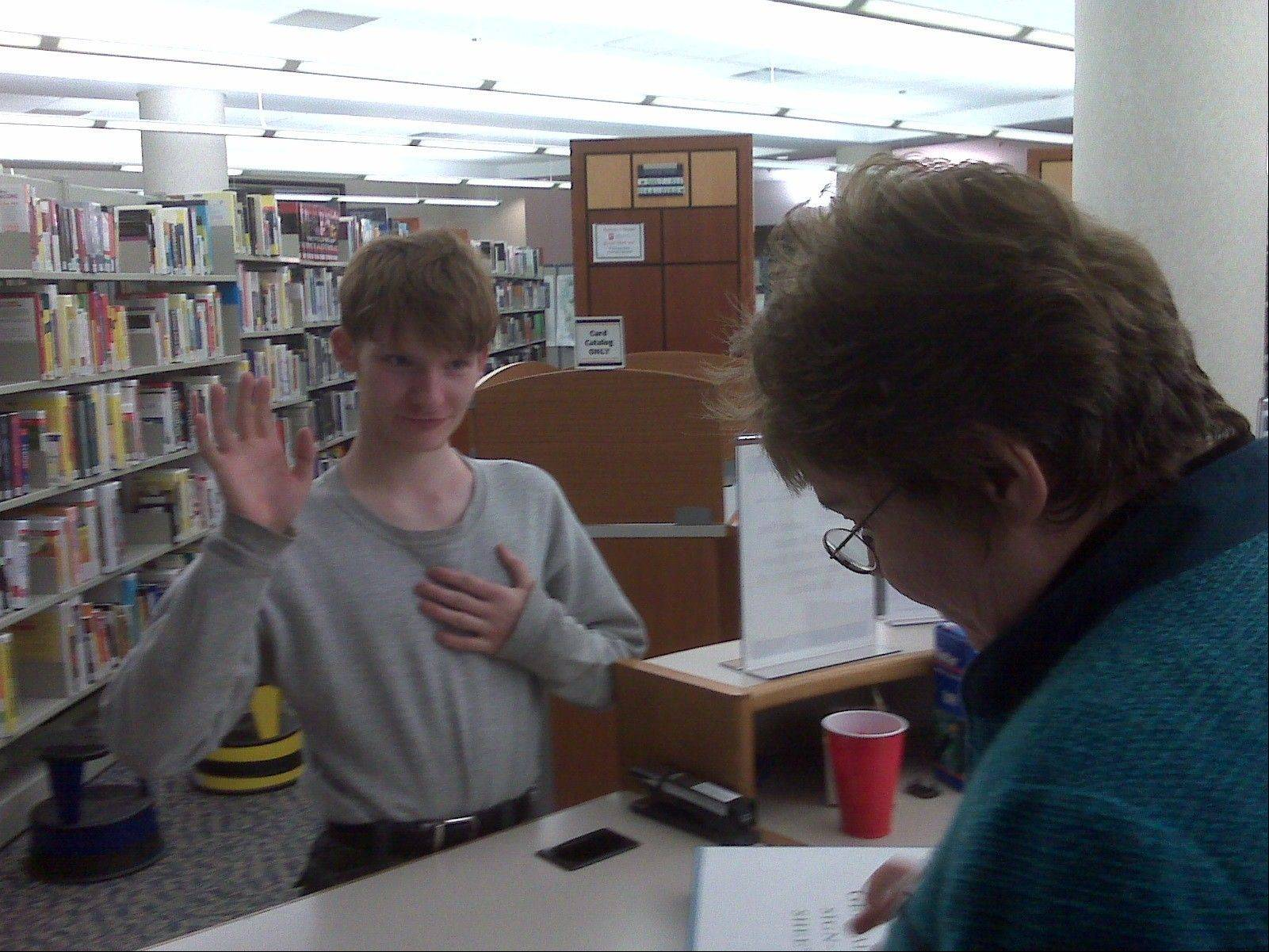 A frequent visitor to libraries, even on vacations, Nick Salvi registers to vote in 2008 at the Fremont Public Library in Mundelein.