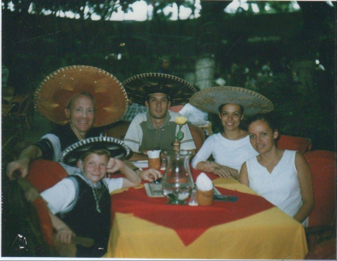Young Nick Salvi, front left, sits next to his dad, Al, and their friends during this outing during a vacation in Mexico.