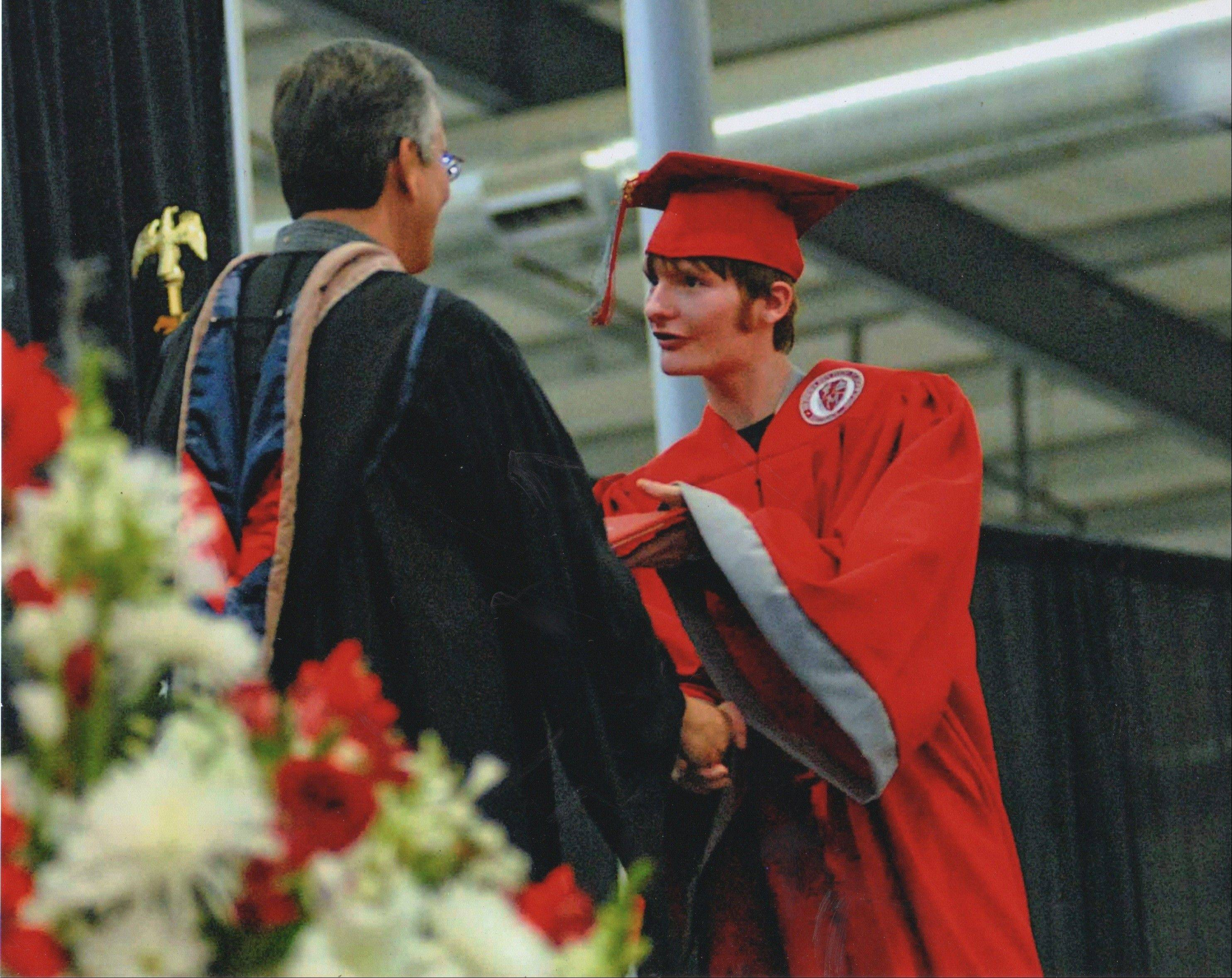 With the unending support of his parents and educators, Nick Salvi graduates from Mundelein High School with the class of 2010.