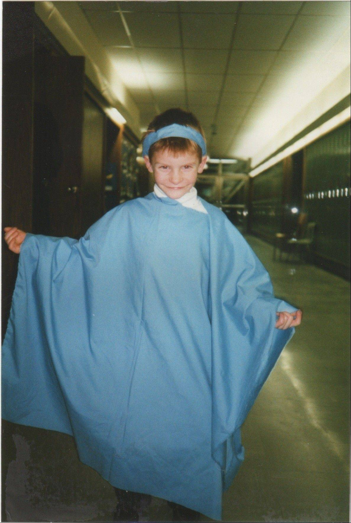 Shown here portraying an angel for a play in 1994, Nick Salvi of Wauconda would be diagnosed at age 18 with a rare disorder known as Angelman syndrome.