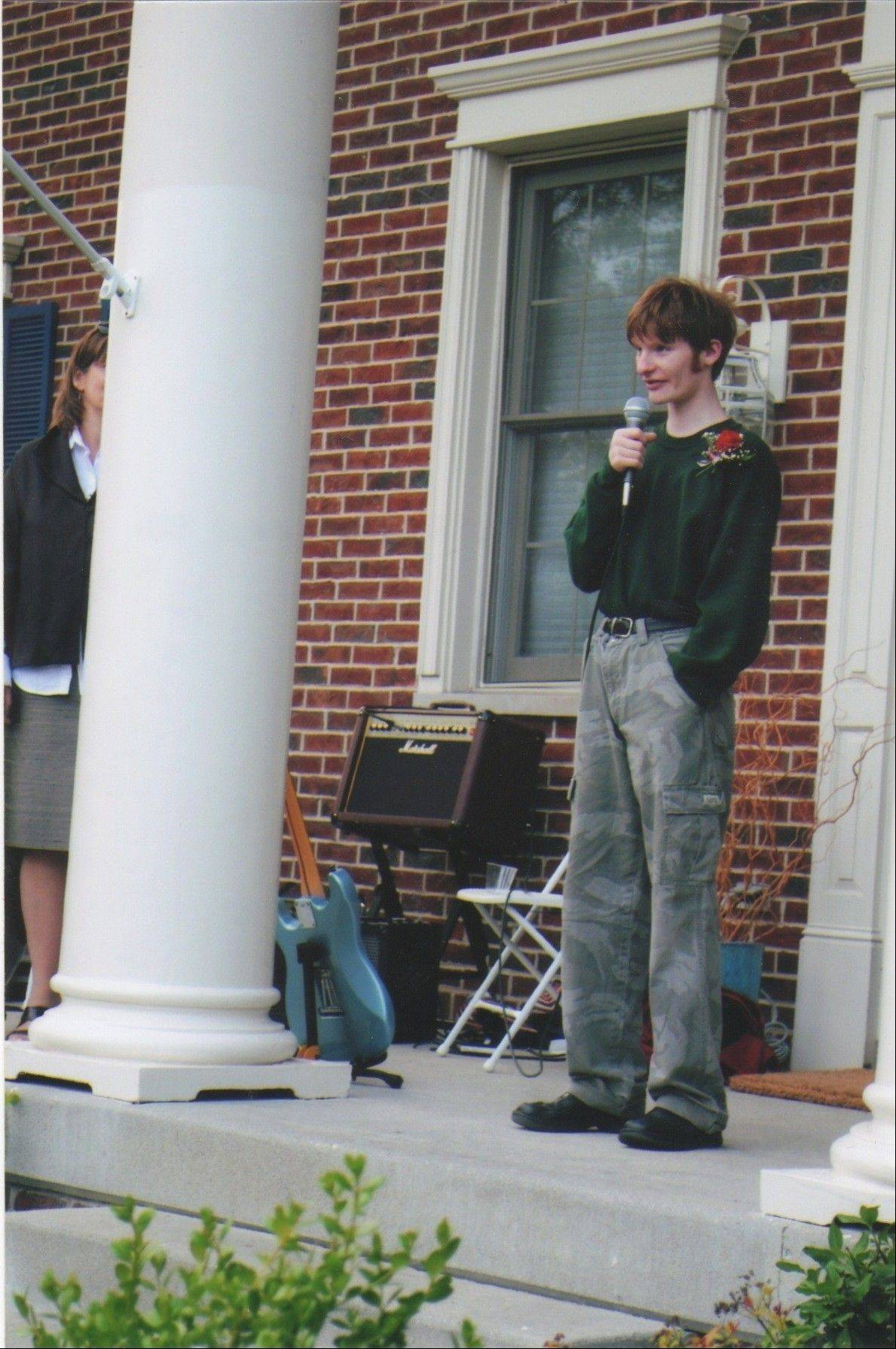 During the party celebrating his graduation from Mundelein High School in 2010, Nick Salvi makes a speech from the front of his home in Wauconda.