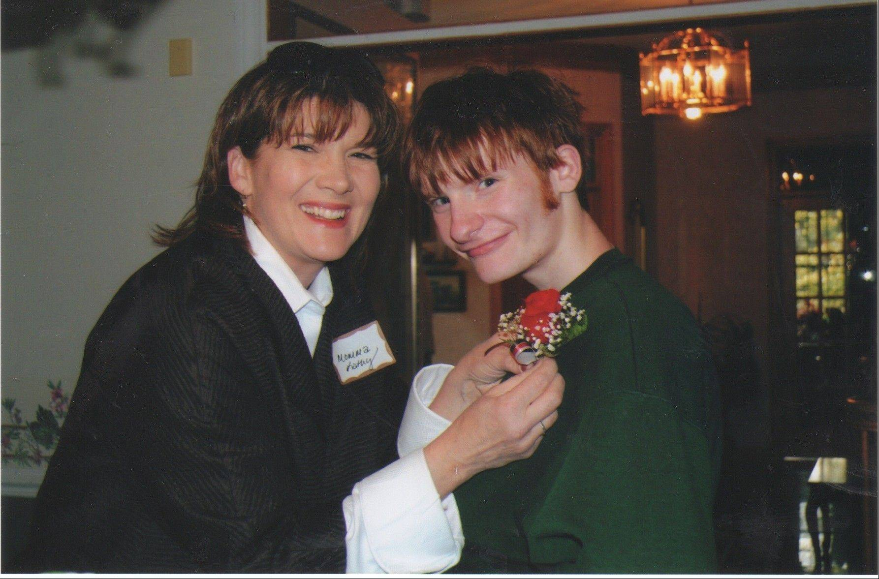 Pinning on this boutonniere to celebrate Nick Salvi's high school graduation capped off the years of dedicated work Kathy and Al Salvi put into making sure their son would reach that goal.