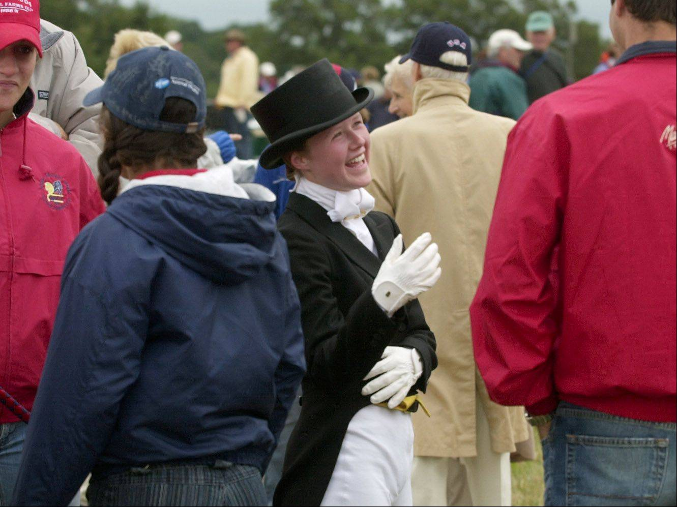 Ashley Smith of Barrington Hills chats with friends and family after competing in a dressage event at the 2004 North American Young Riders' Championships at Tempel Farms in Wadsworth. Horse competitions such as this are far more common than the controversial quarter horse races in McHenry County that officials are looking to regulate in coming months.