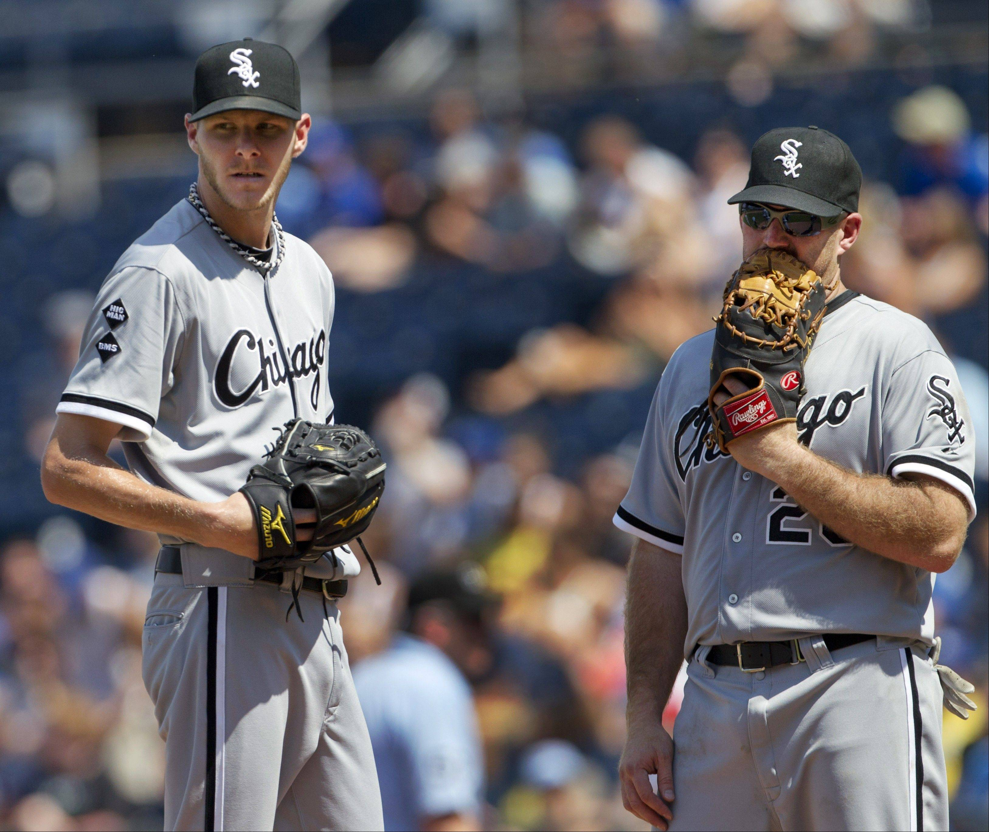 White Sox third baseman Kevin Youkilis talks with starting pitcher Chris Sale during the eighth inning of Sunday's 2-1 victory over the Royals.